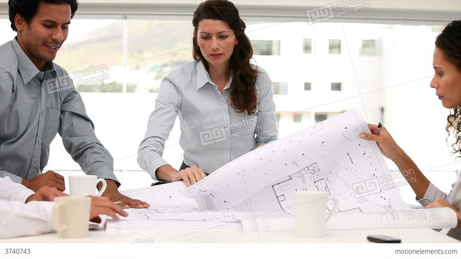 Architect looking at a blueprint map in a meeting stock video architect looking at a blueprint map in a meeting stock video footage malvernweather Gallery