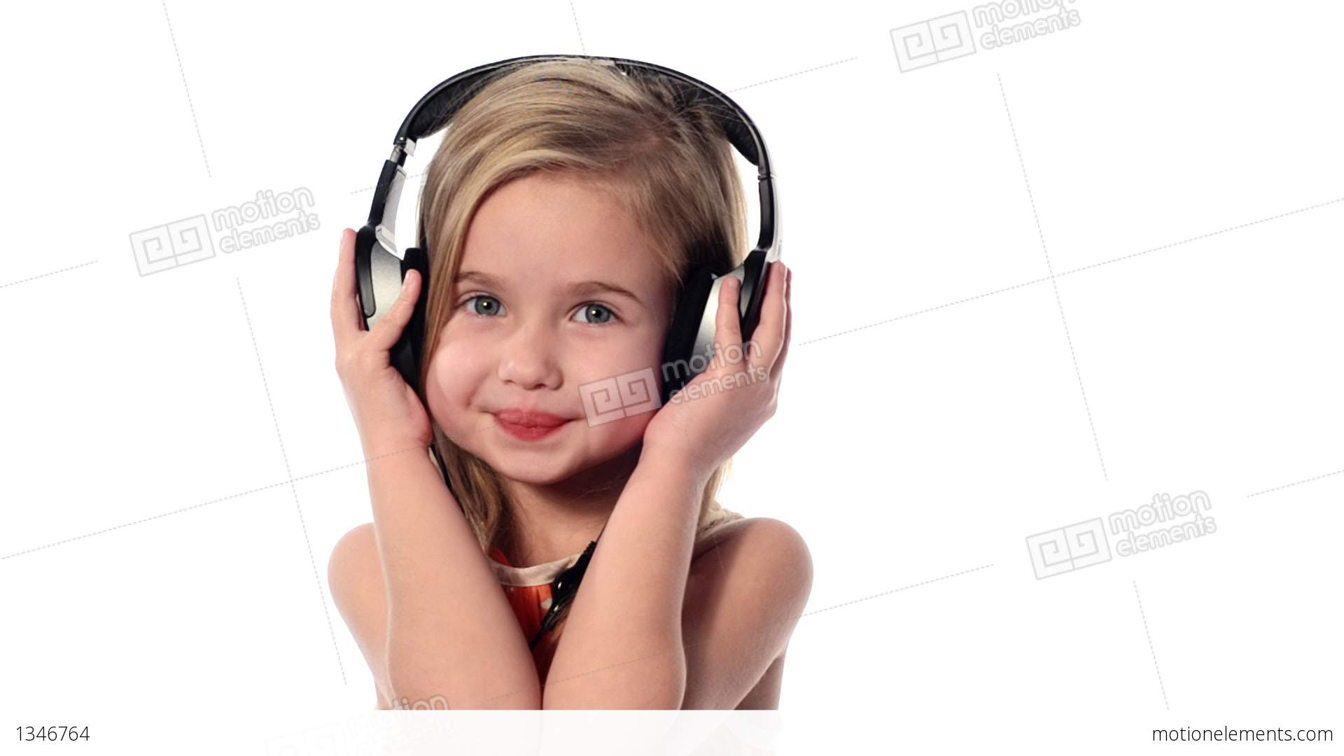 Little Girl Listening To Music On Headphones Stock video ...