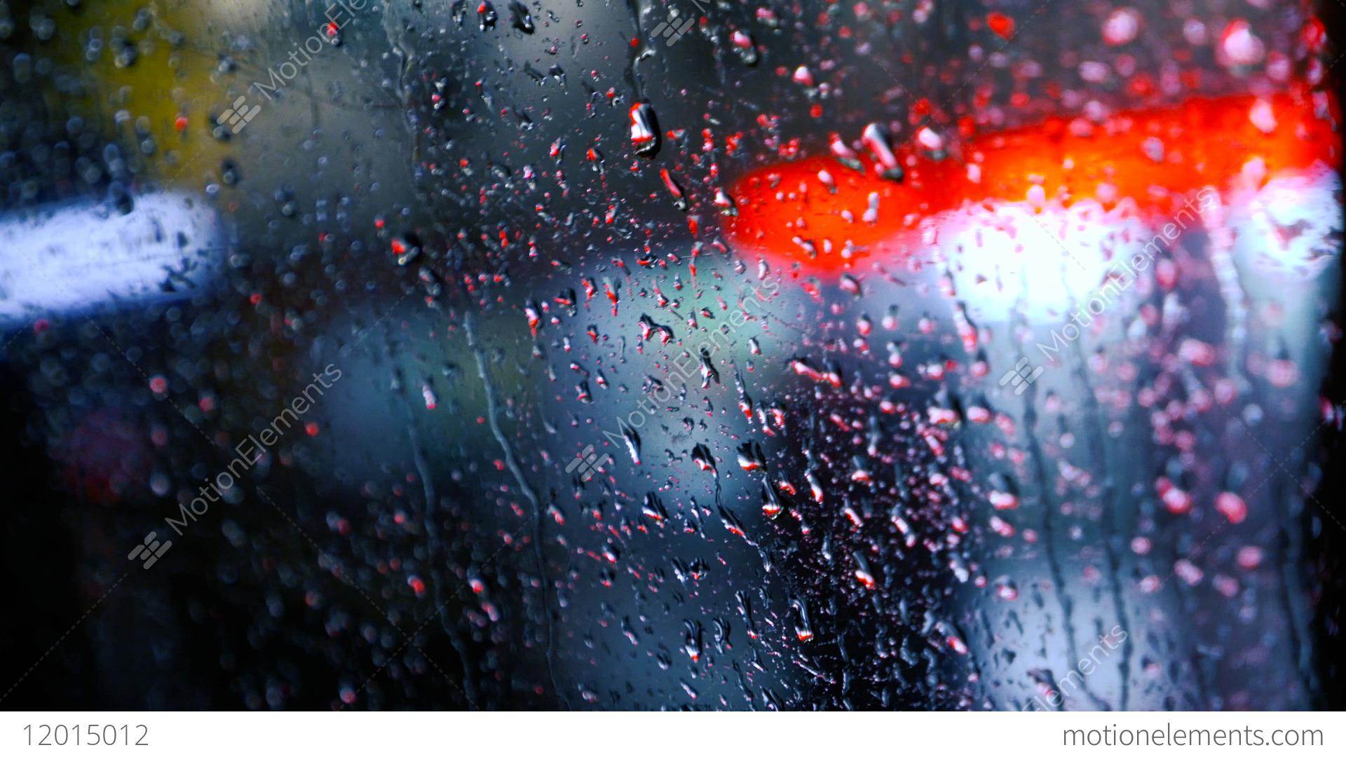 Blurred Rain Drops At Car Window And Night Lights Stock Video