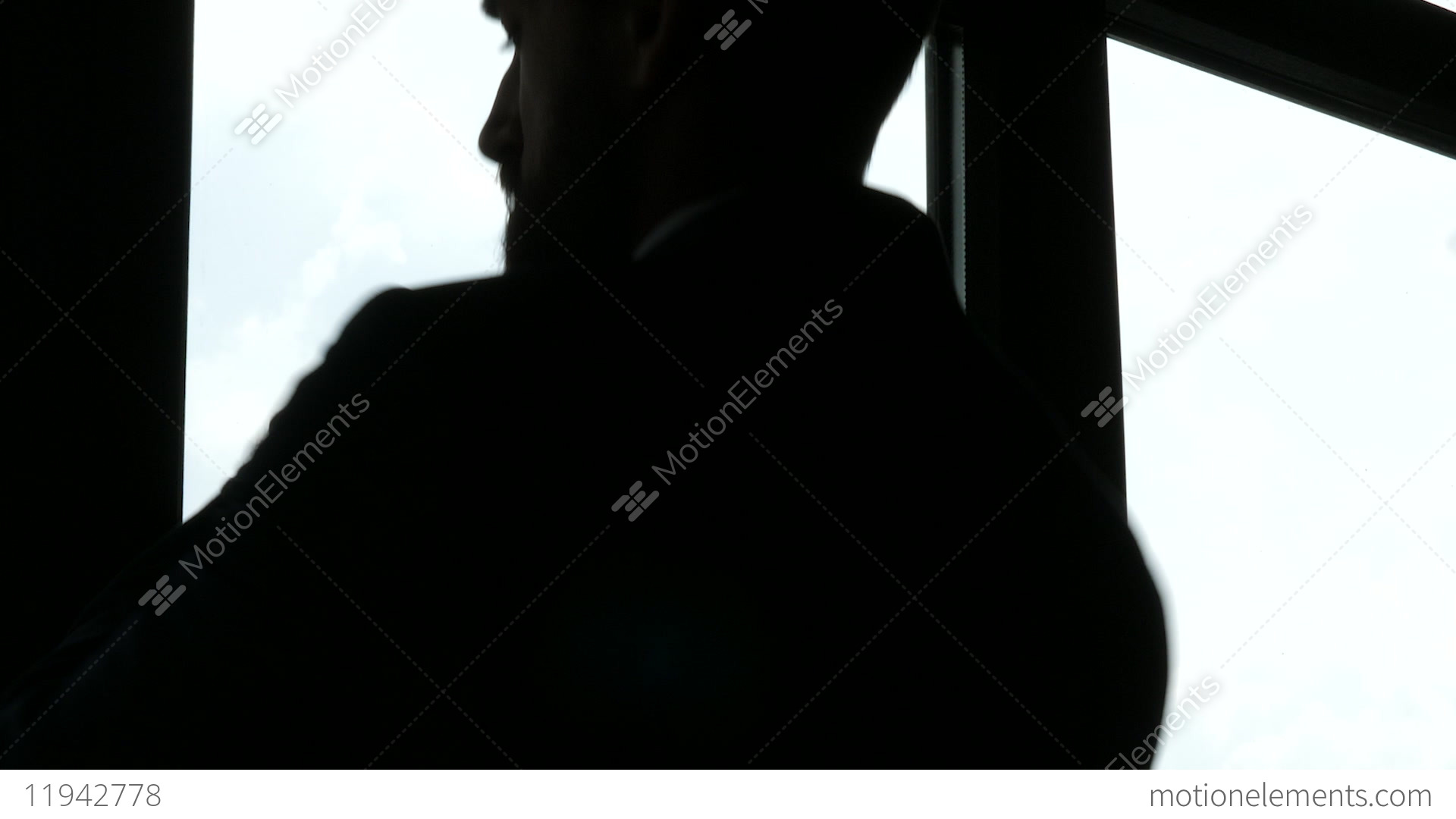tired exhausted and stressed businessman silhouette approaches the