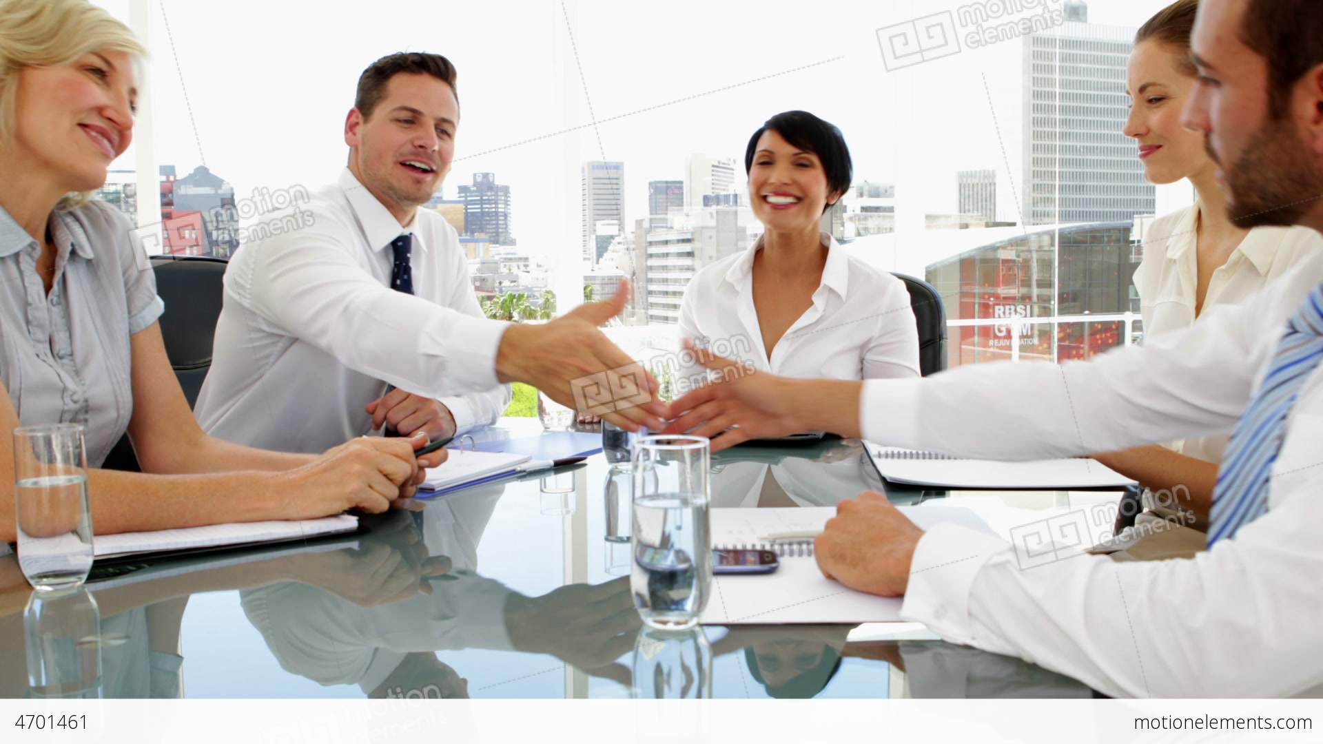 me4701461-happy-business-people-shaking-hands-during-meeting-south-africa-hd-a0154.jpg