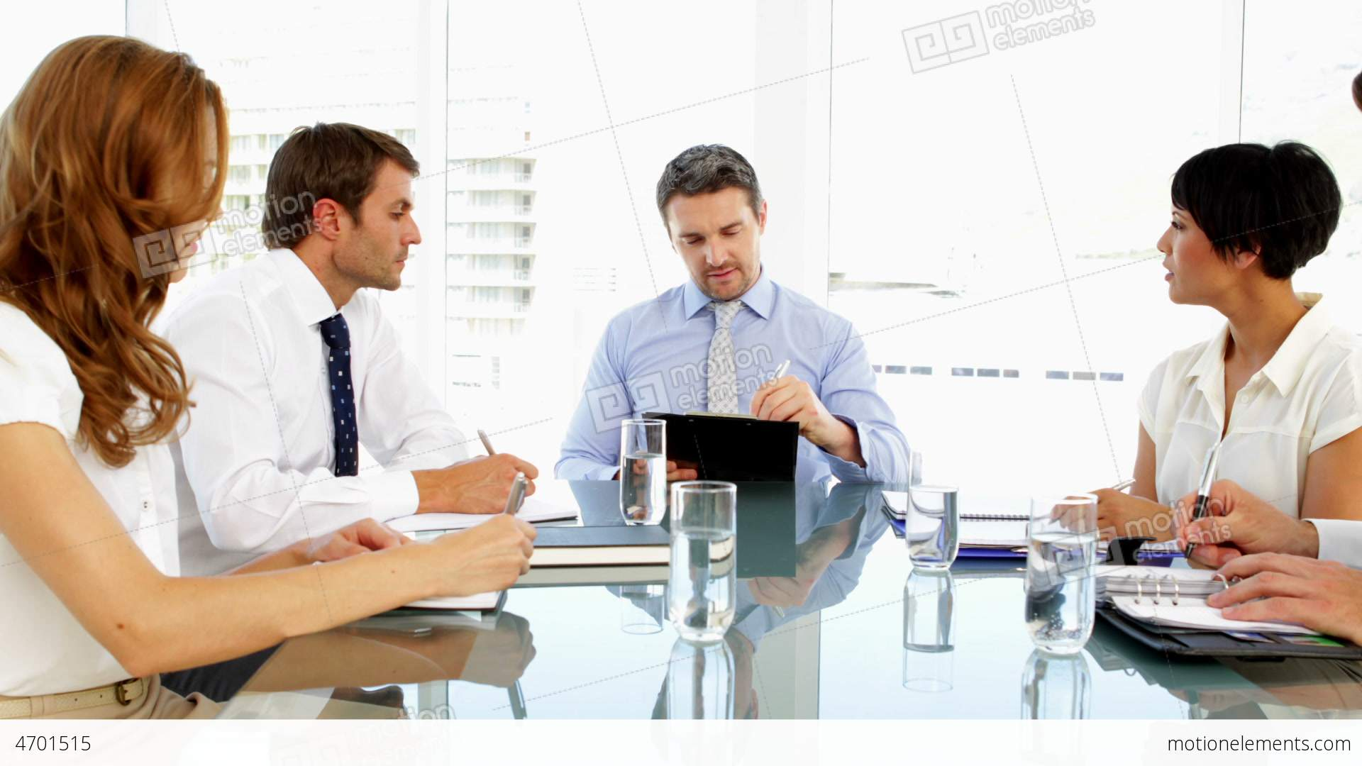 Business people working together during meeting stock for Office photo