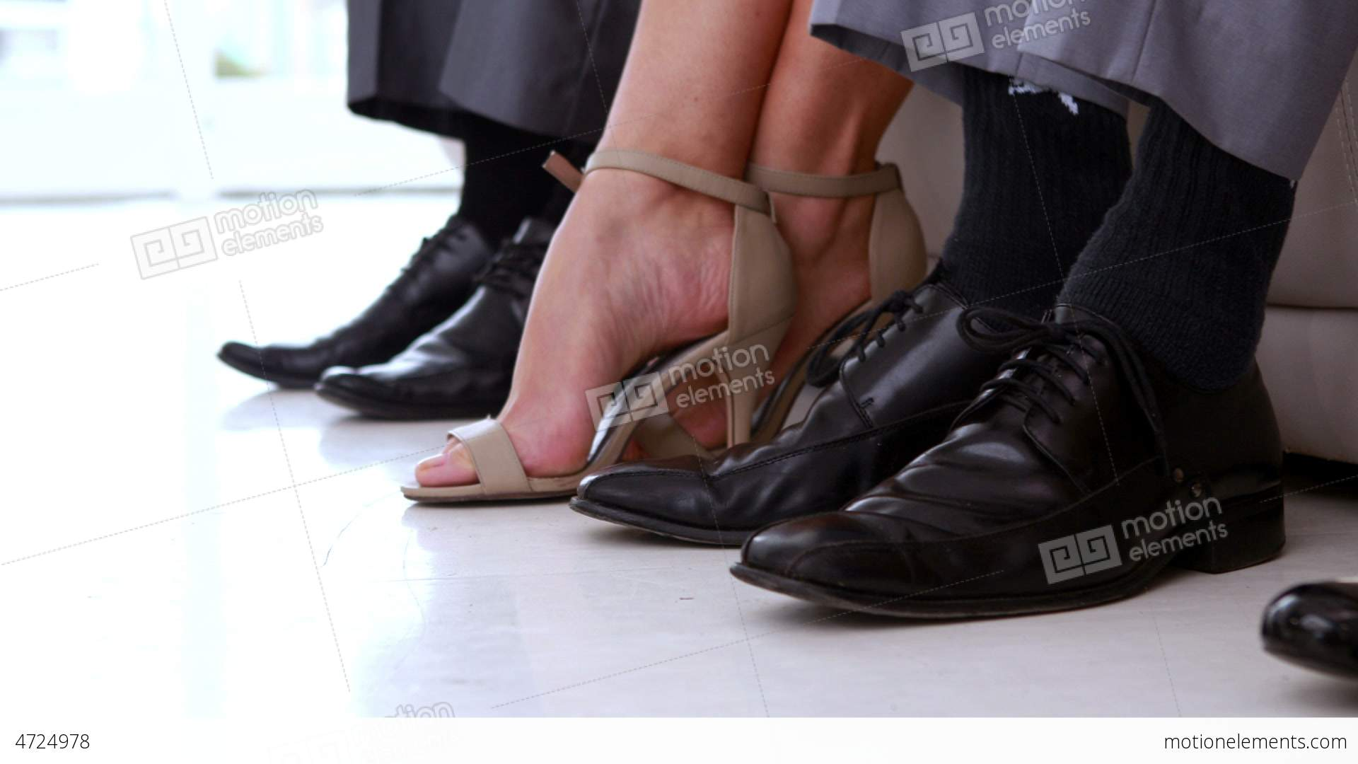 Business People Shaking Feet Nervously Waiting For Interview Stock ...