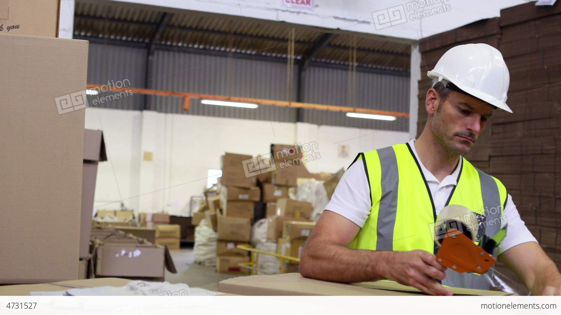 Warehouse worker sealing cardboard boxes for shipping stock video warehouse worker sealing cardboard boxes for shipping stock video footage sciox Choice Image