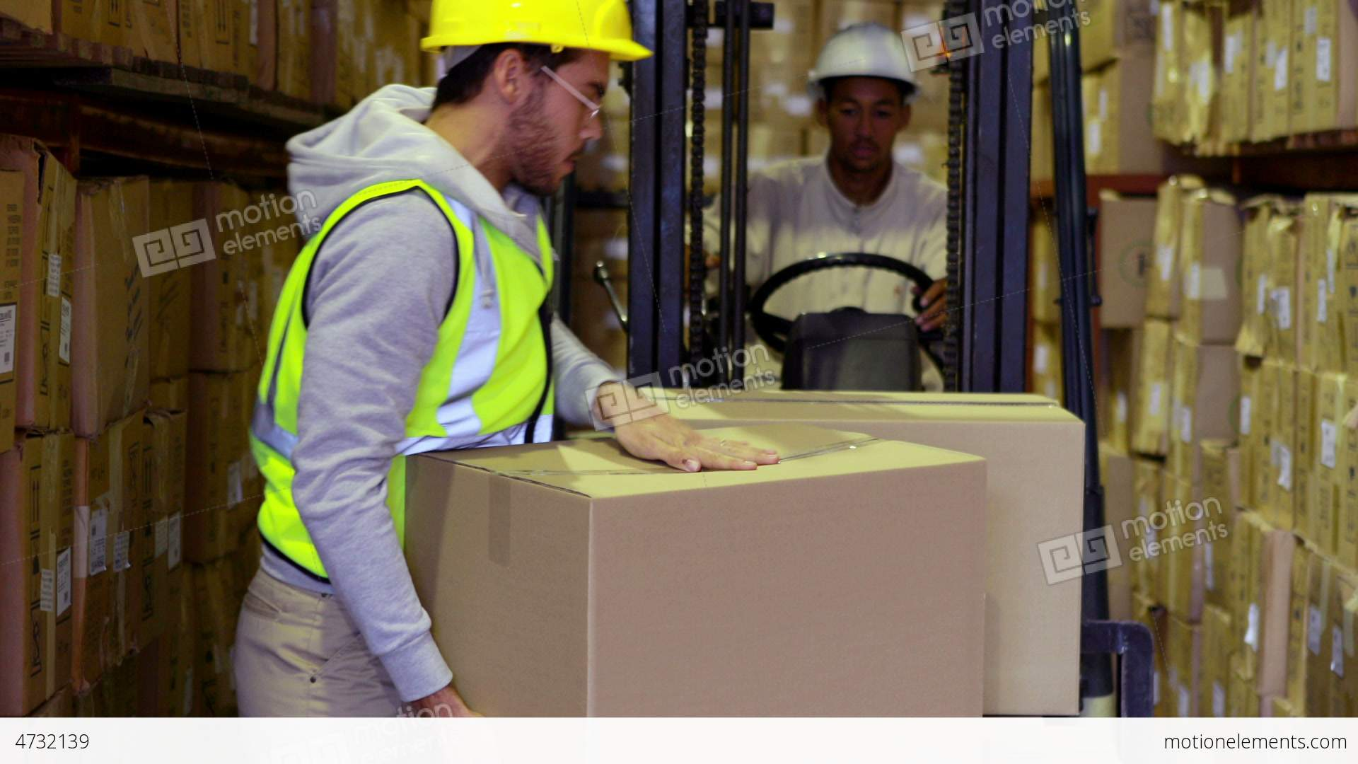 Warehouse worker packing boxes on forklift stock video footage warehouse worker packing boxes on forklift stock video footage sciox Choice Image
