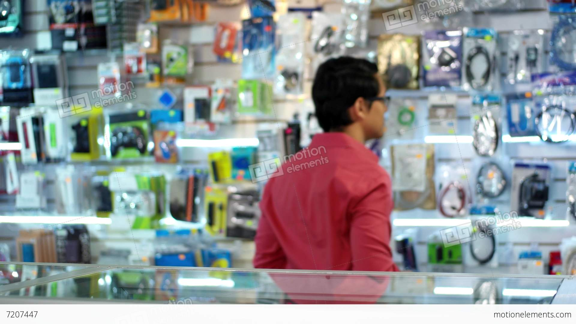 chinese man working as clerk assistant in computer shop alt video chinese man working as clerk assistant in computer shop