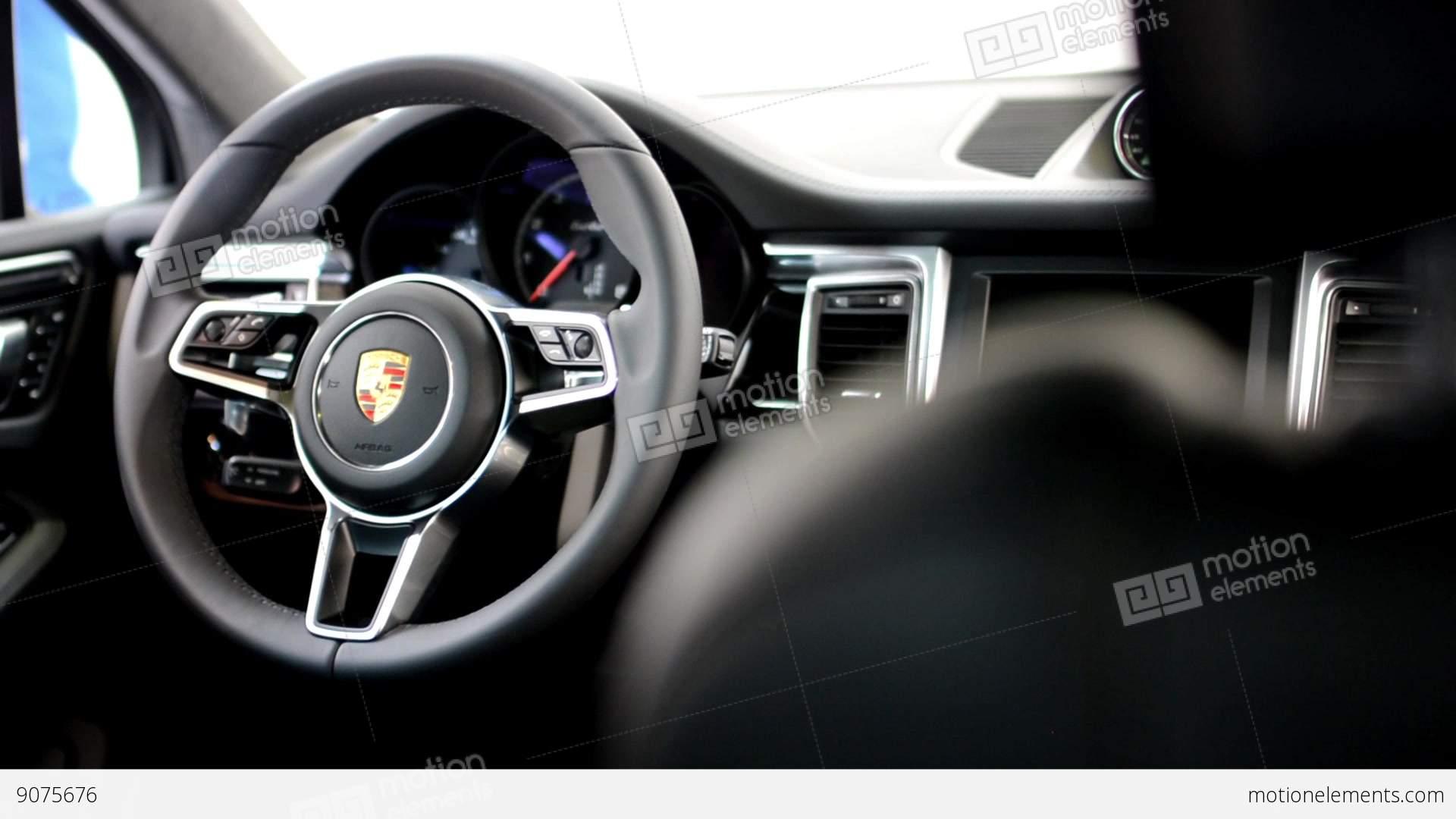 Dashboard Wheel And Detail Of Logo Seat Porsche Suv Stock Business Transportation Symbols