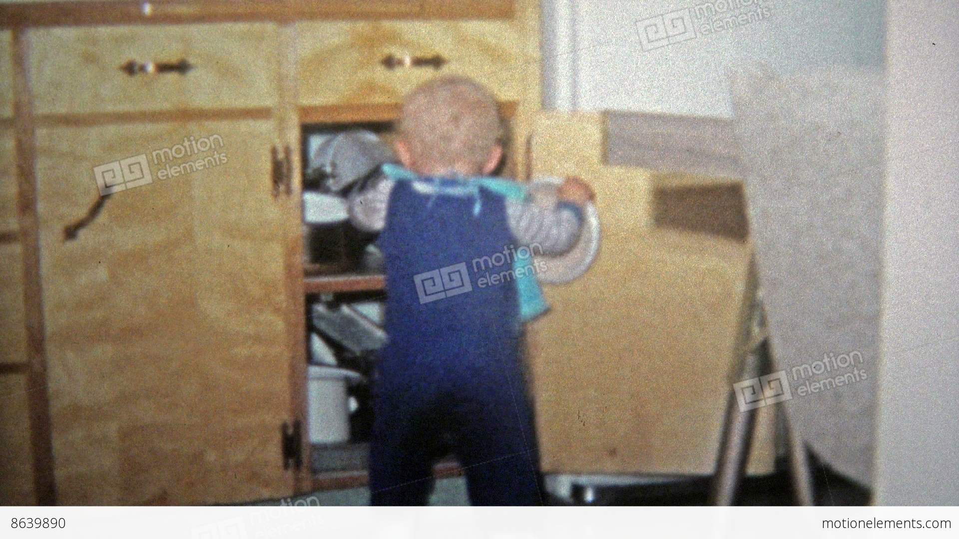 TOLEDO, OHIO 1968: Toddler Boy Playing With Pots In... Stock Video