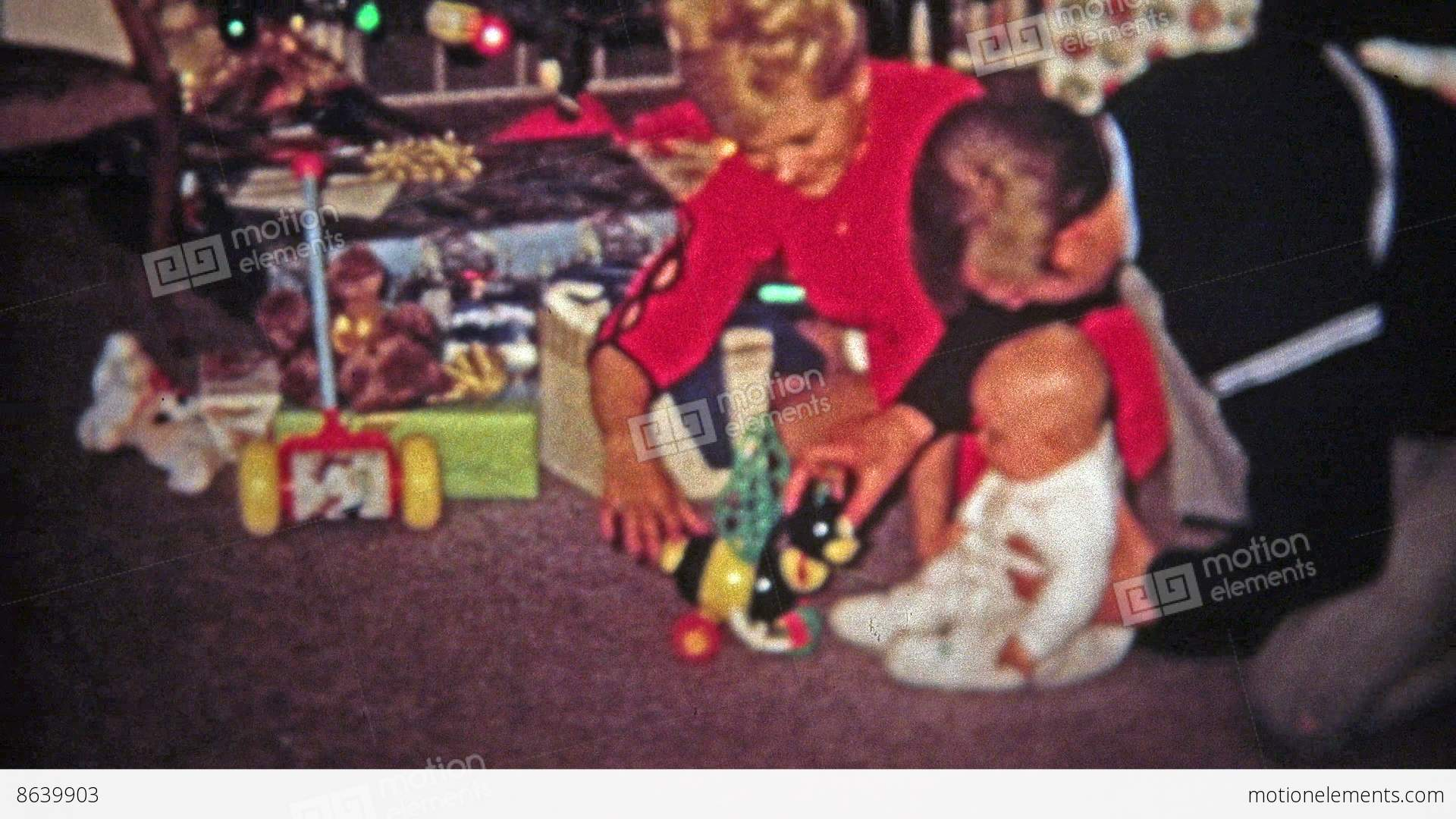 TOLEDO, OHIO 1968: Mom Dad Baby Play New Christmas Gift Toy Stock ...