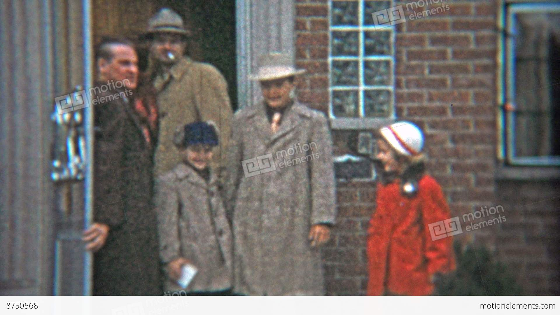 1953 gangster fashion dressed up family leaving house in winter