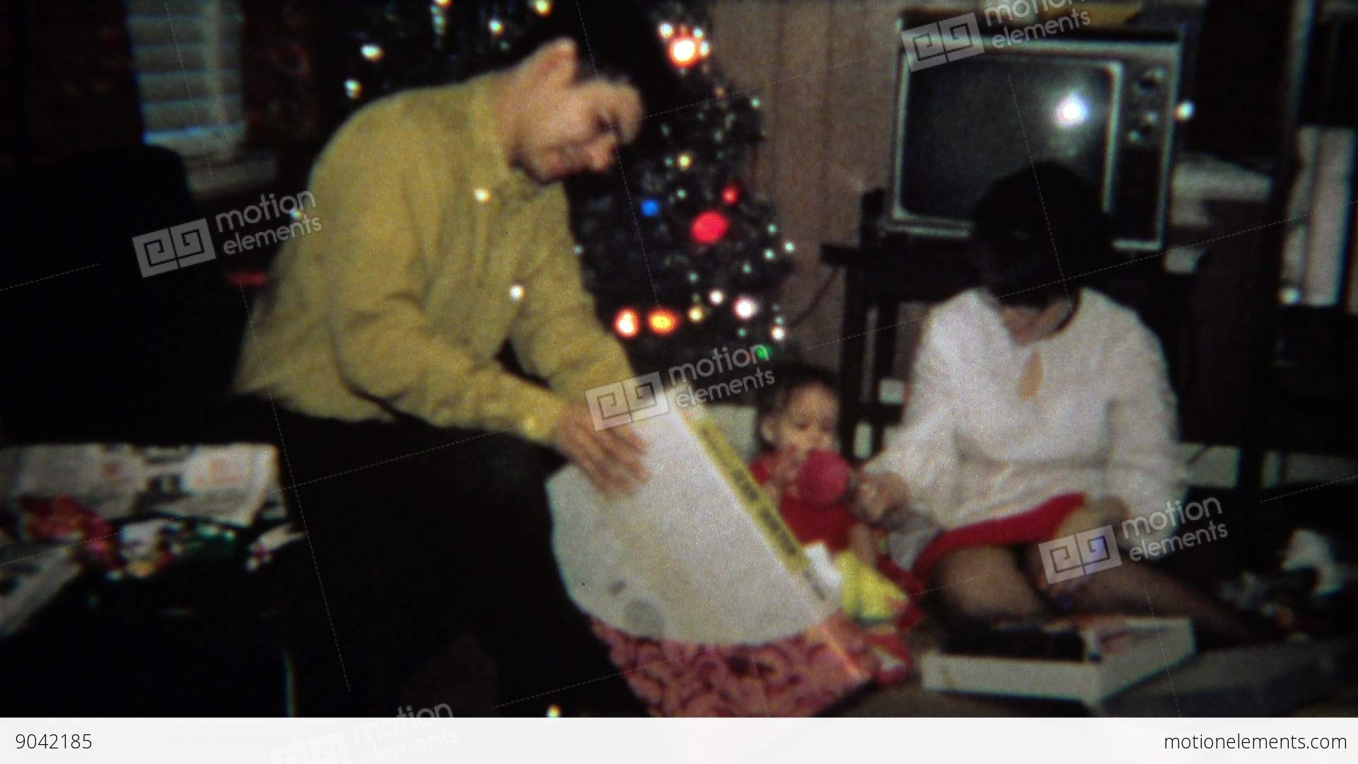 1971: Man Gets Slide Sorter Christmas Gag Gift Stock video footage ...