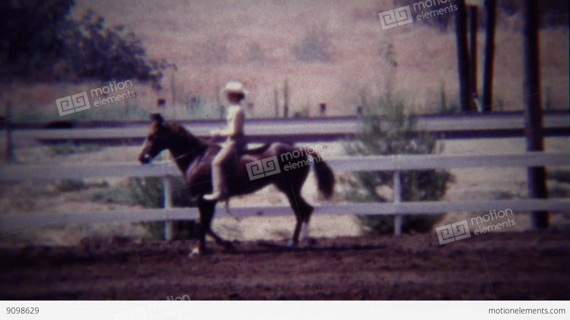 1967: Female Horse Rider In White Costume Practicing Control Stock video  footage