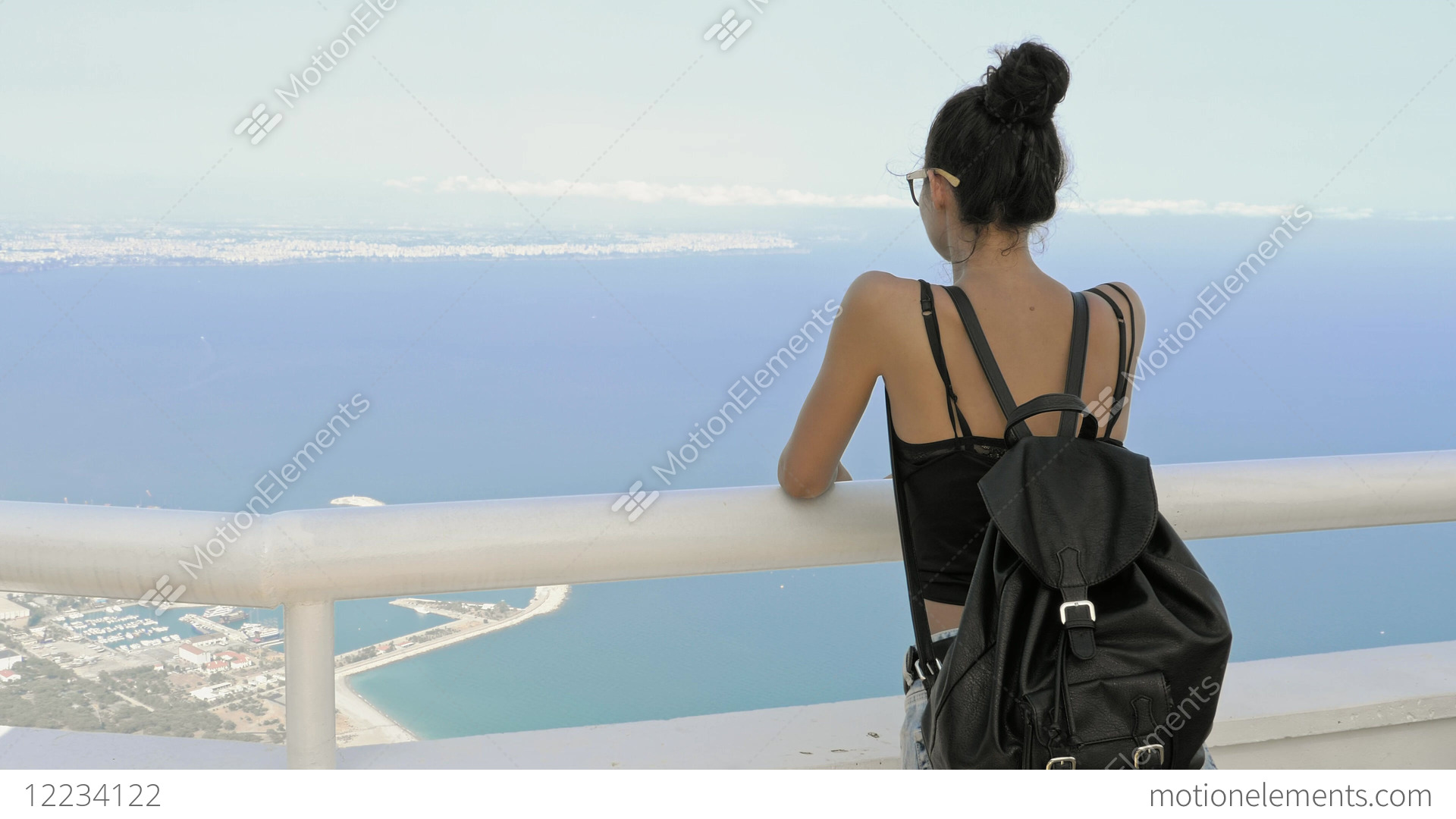 Beautiful young tourist girl with backpack near sea Stock Video Footage df3285fdbaa3b