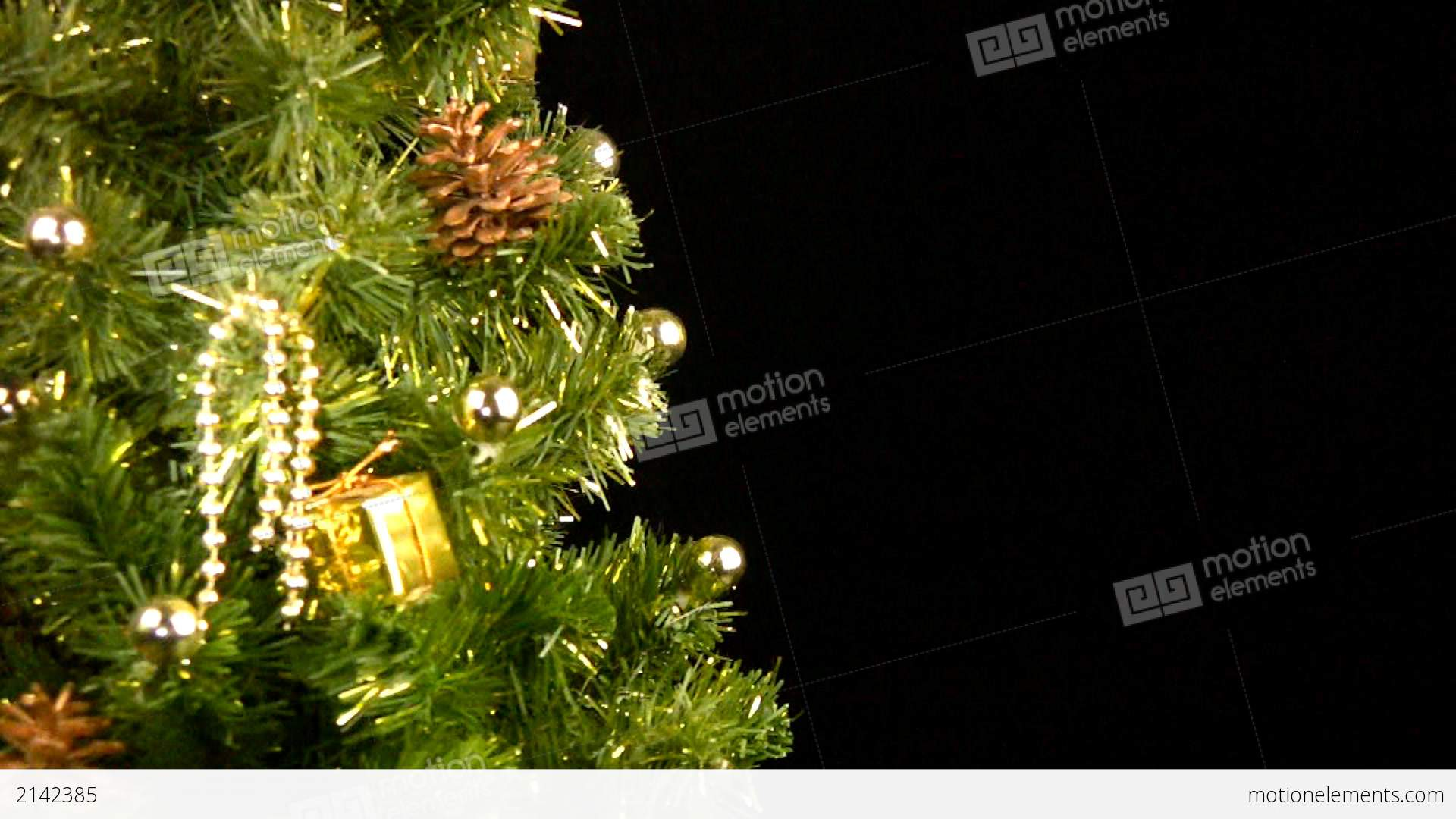 Green christmas tree with gold ornaments rotate stock for Green and gold christmas tree