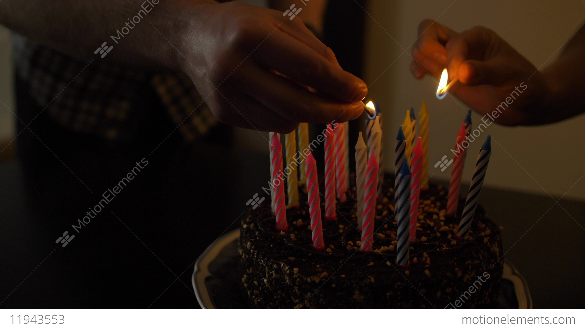 Woman And Man Lights Candles On Tasty Birthday Cake Prepearing For