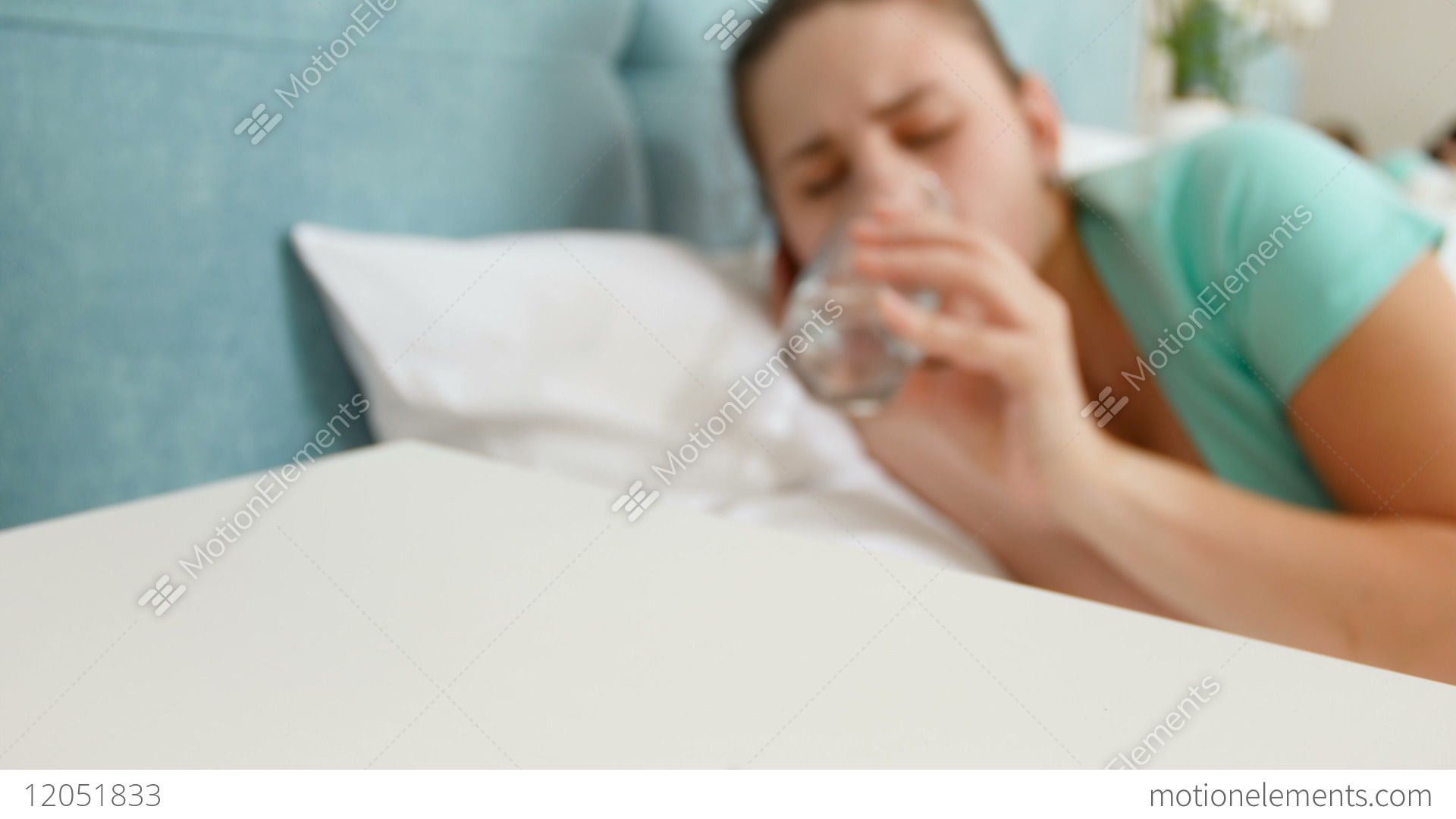 4k Footage Of Young Sick Woman Lying In Bed Taking Pill Stock