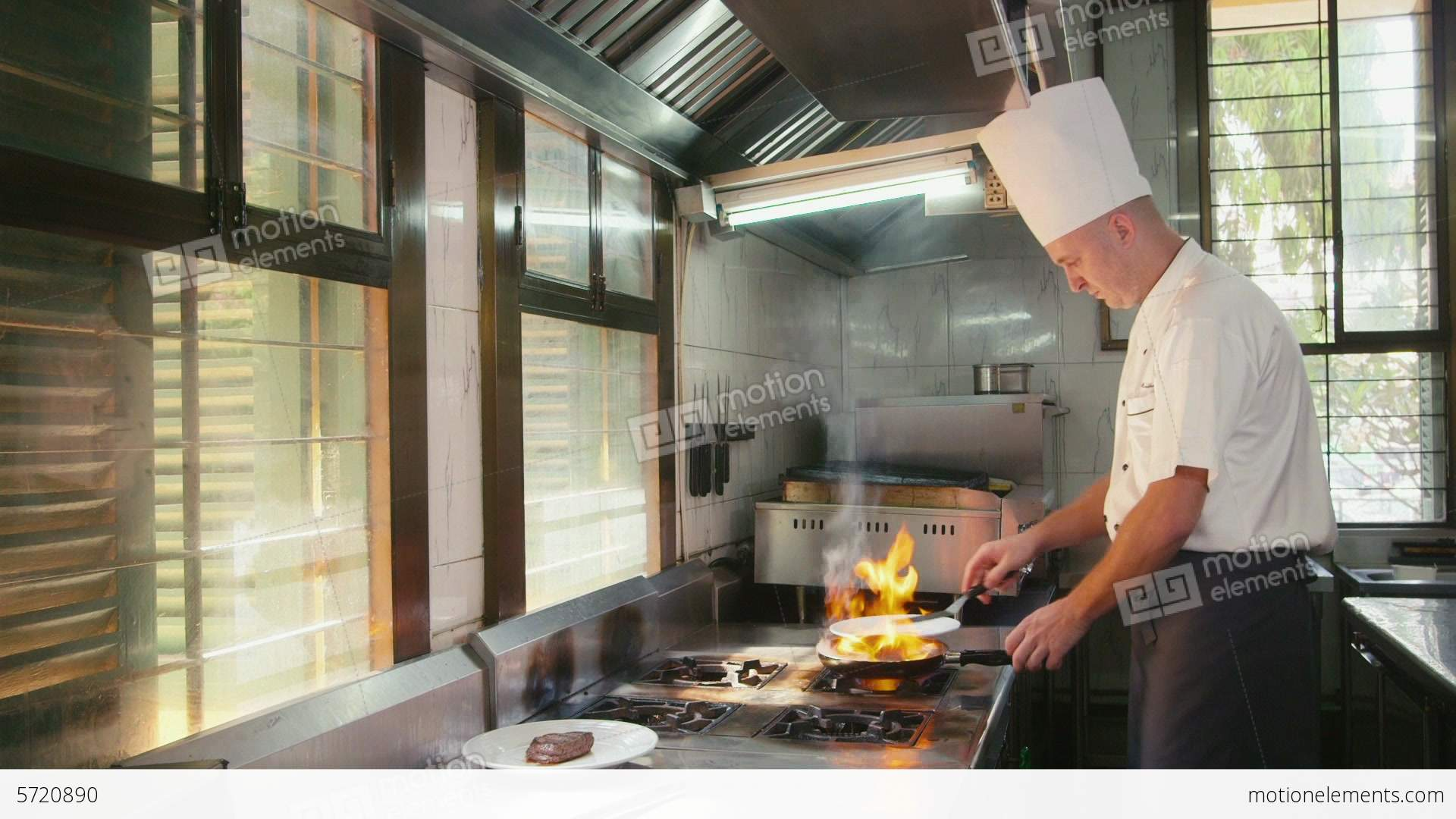 Restaurant Kitchen Video professional chef cooking in restaurant kitchen stock video