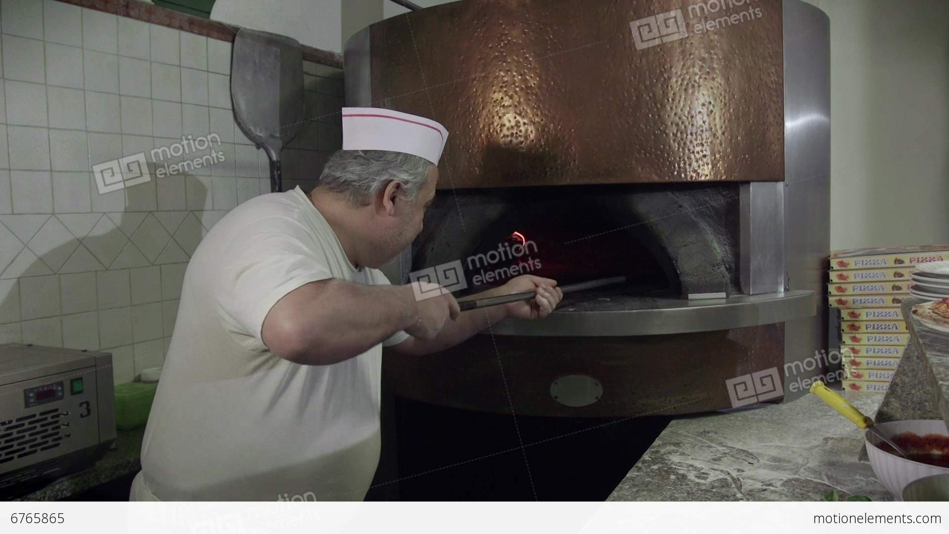 Restaurant Kitchen Video portrait man at work cook pizza restaurant kitchen video | 6765865