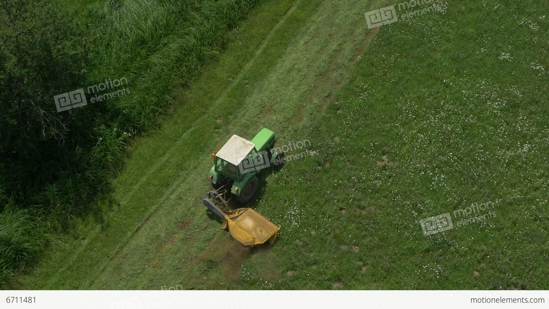 grass field aerial. AERIAL: Flying Above The Tractor Cutting Grass Stock Video Footage Field Aerial P