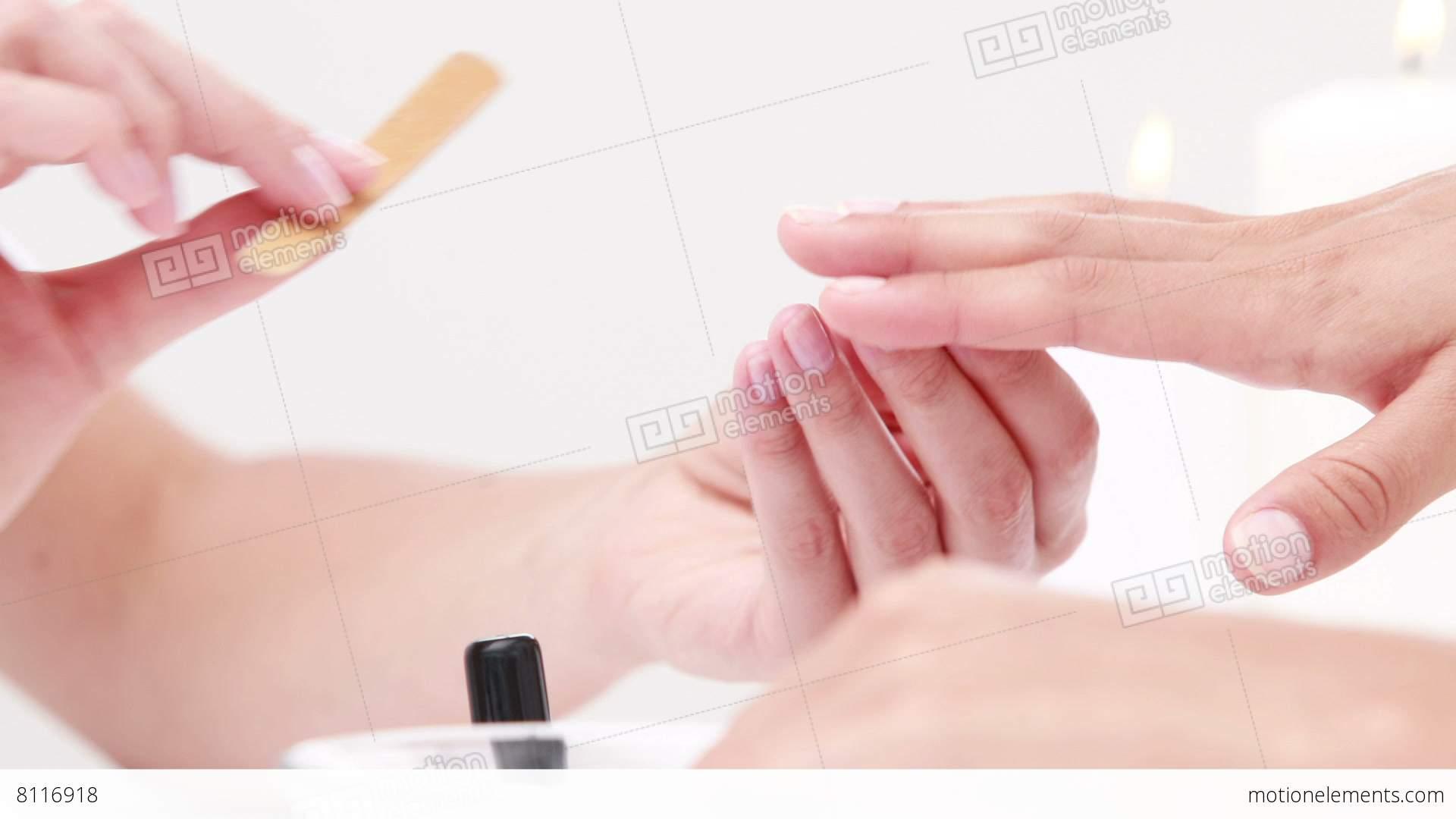 Woman getting a manicure at nail salon lizenzfreie videos for At nail salon