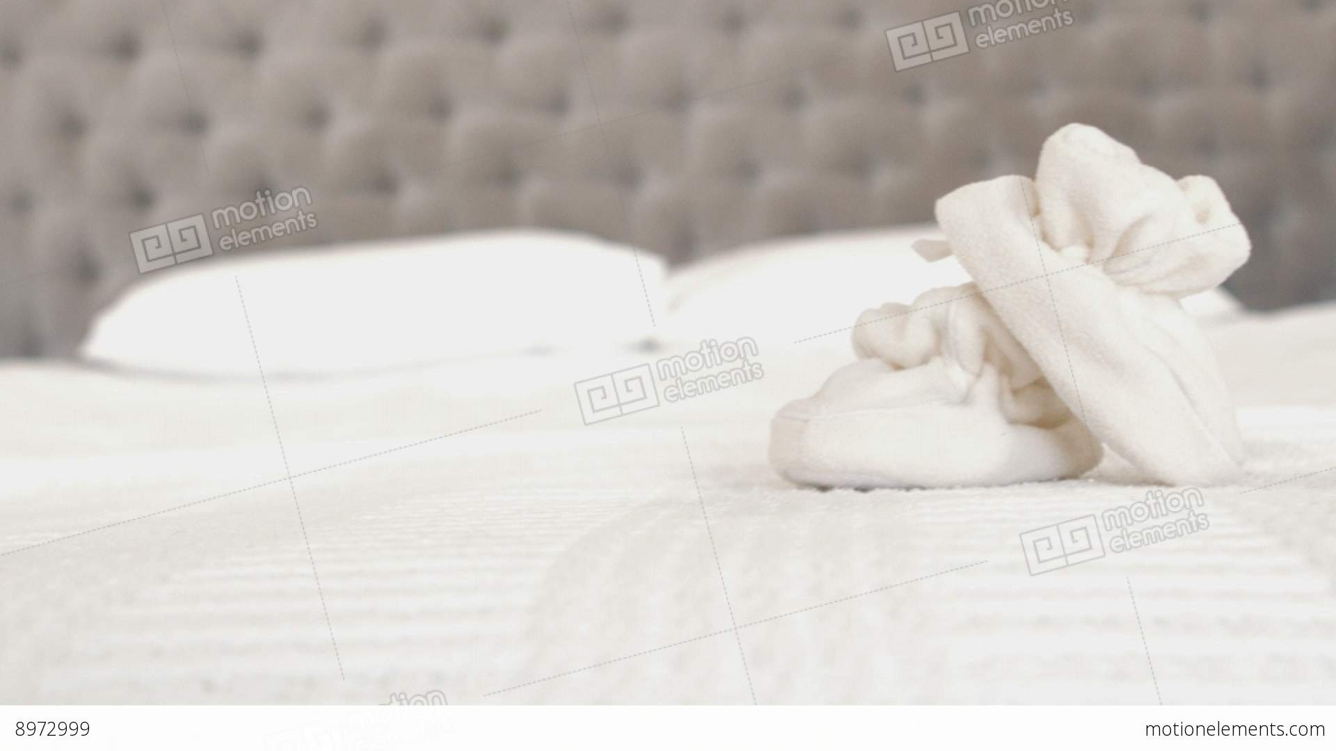 White Cut Baby Shoes The Bed Stock video footage