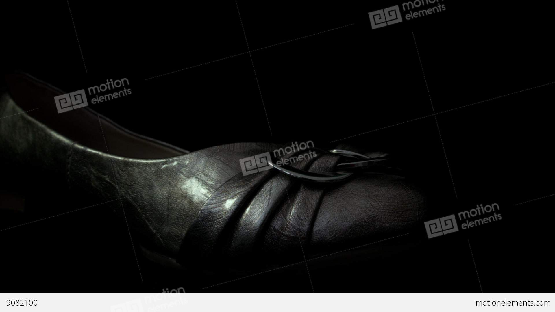Silver Shoe Isolated Against A Black Background HD Stock