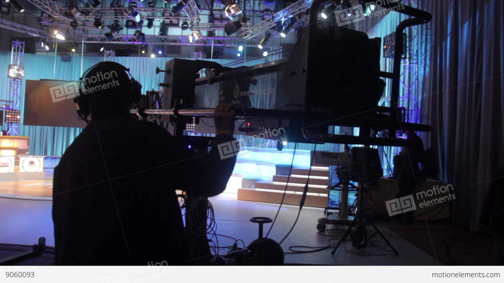the man controls the crane with the camera in the tv studio during