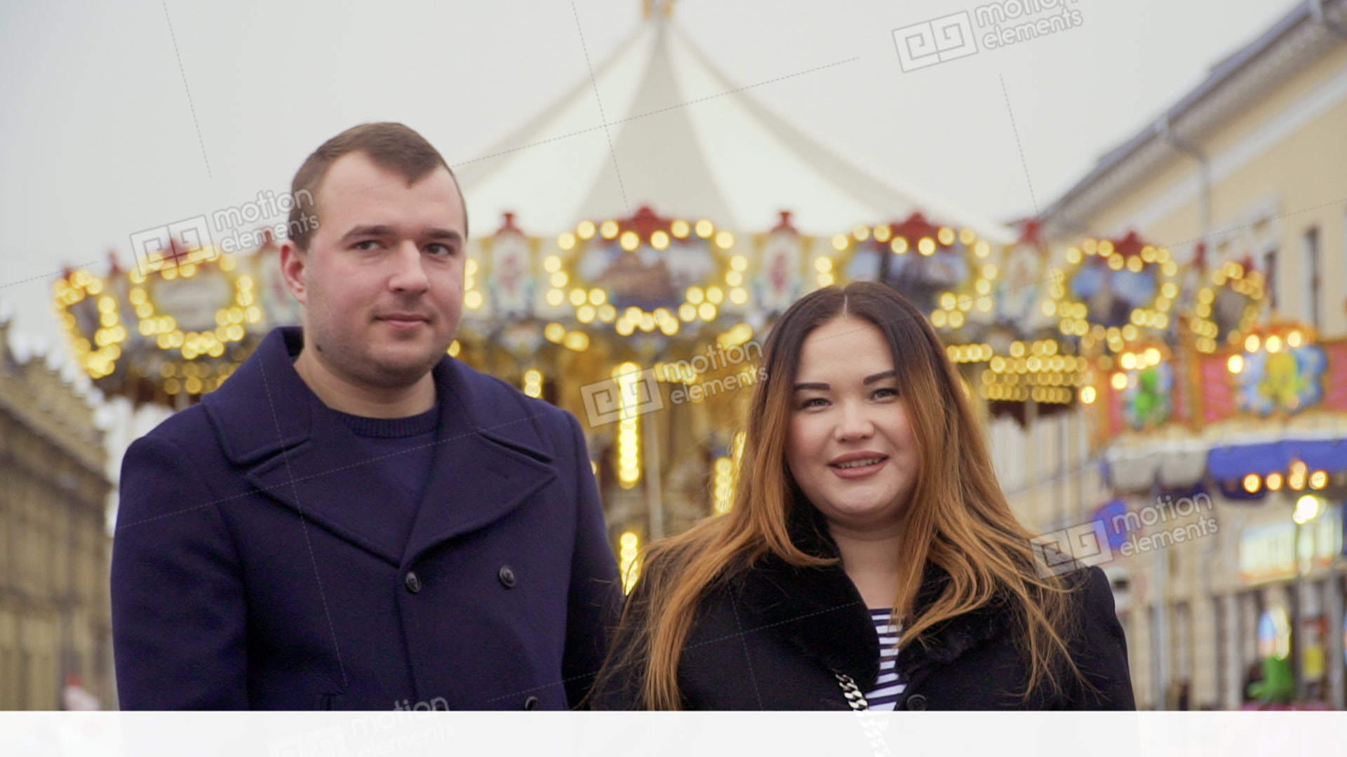 Happy adult couple at carousel background Stock Video Footage