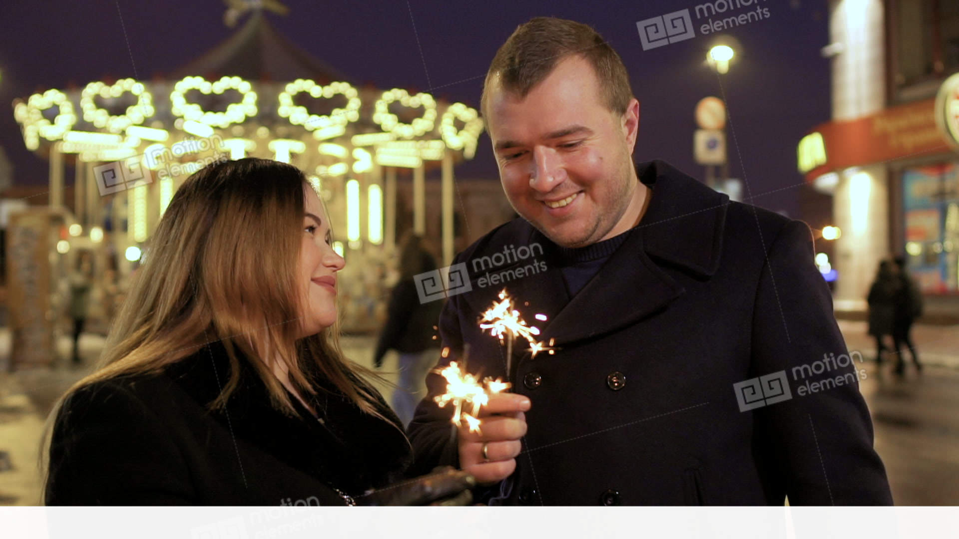 Adult in love couple with sparklers at carousel background Stock Video  Footage