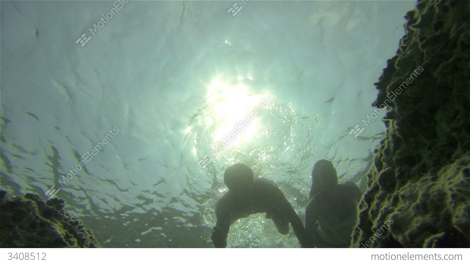 UNDERWATER: Couple Swimming Holding Hands Stock Video