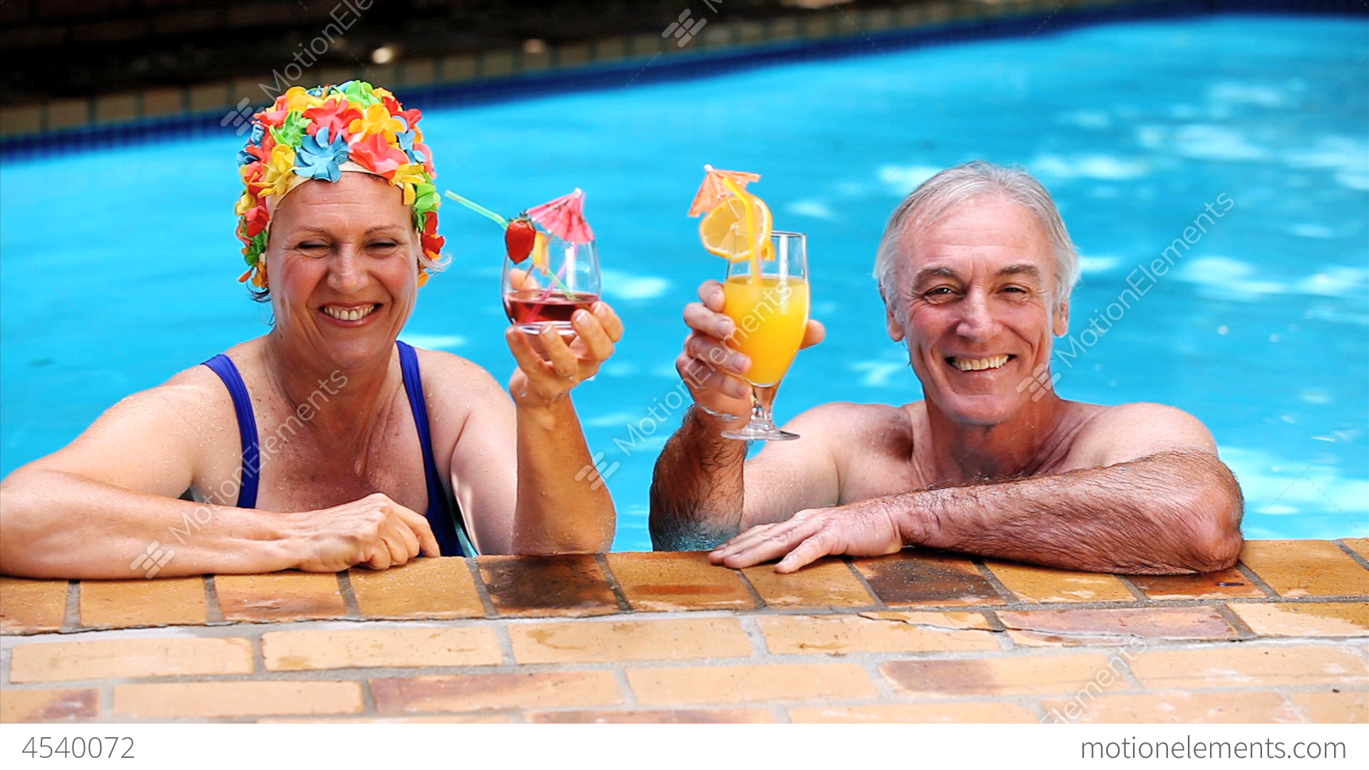 Happy old couple relaxing in the swimming pool stock video for What to do with old swimming pool