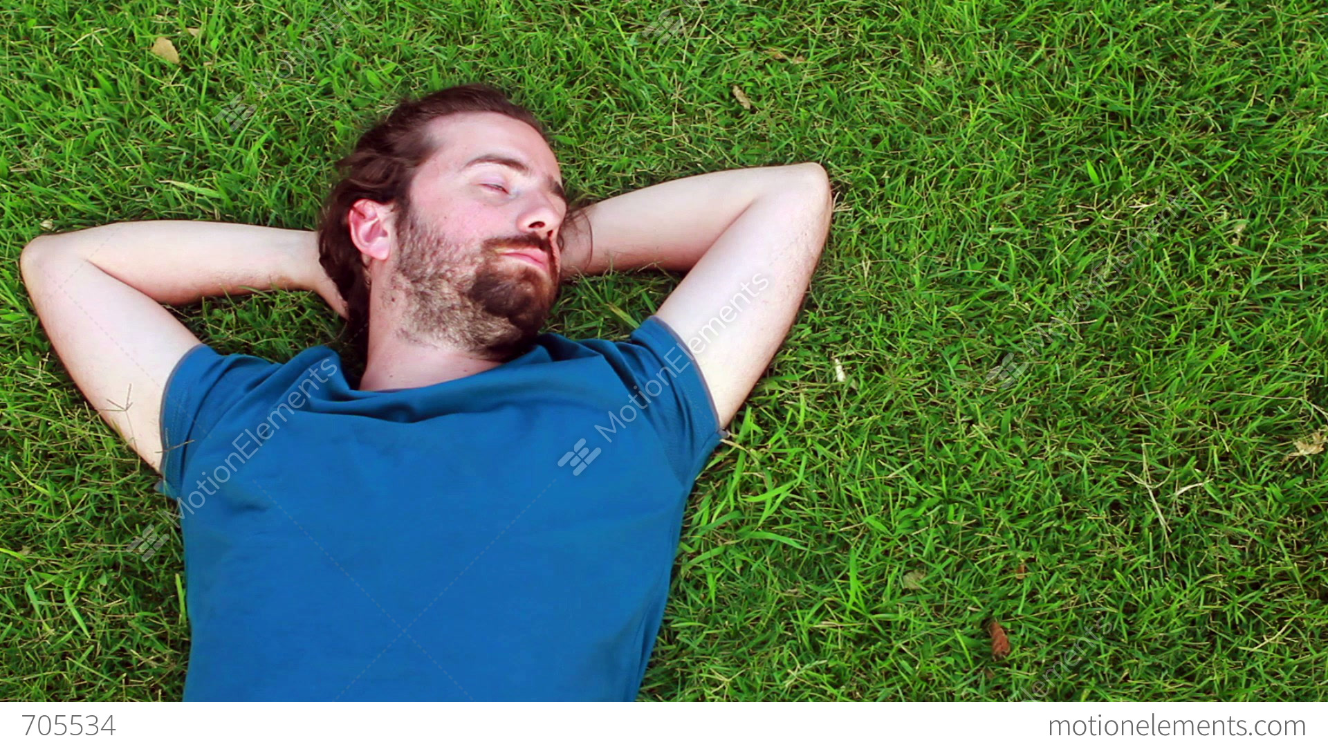 Young Guy Lie Down On Grass Stock video footage | 705534