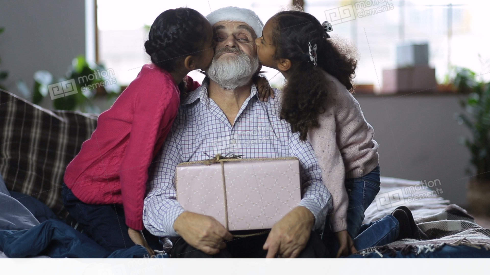 lovely girls giving a kiss to grandpa at christmas stock video footage - Grandpa For Christmas