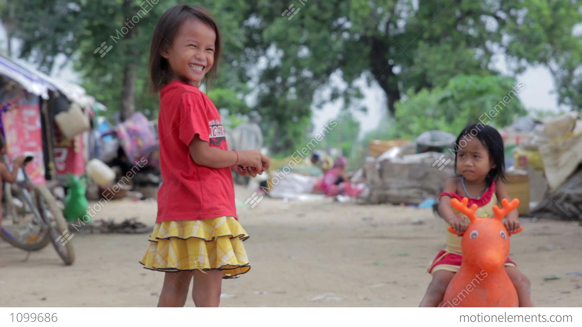 PHNOM PENH, CAMBODIA - JUNE 2012: Cambodian Kids In Slums