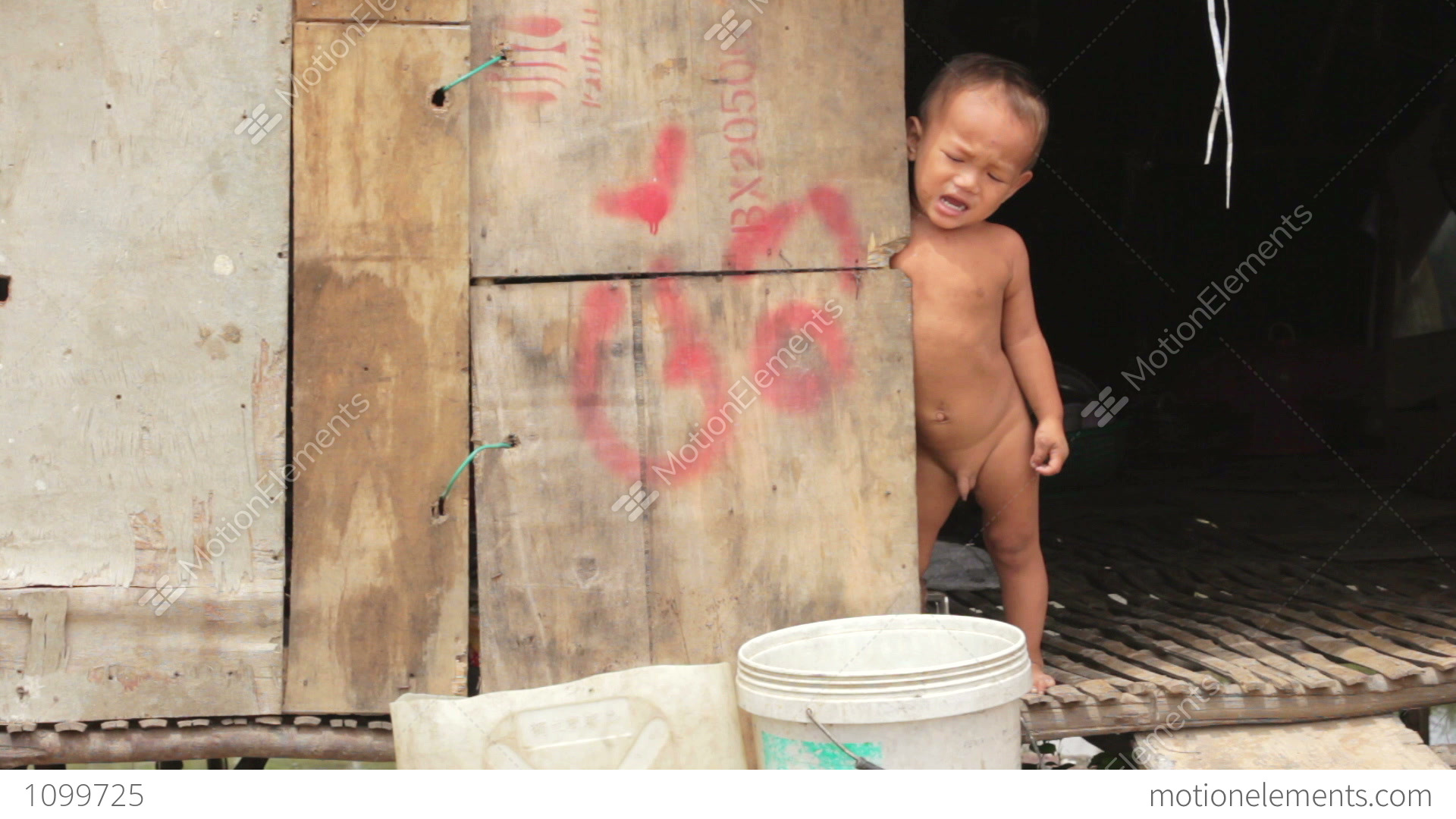 Naked Baby Crying In Shack Stock Video Footage  1099725-6553