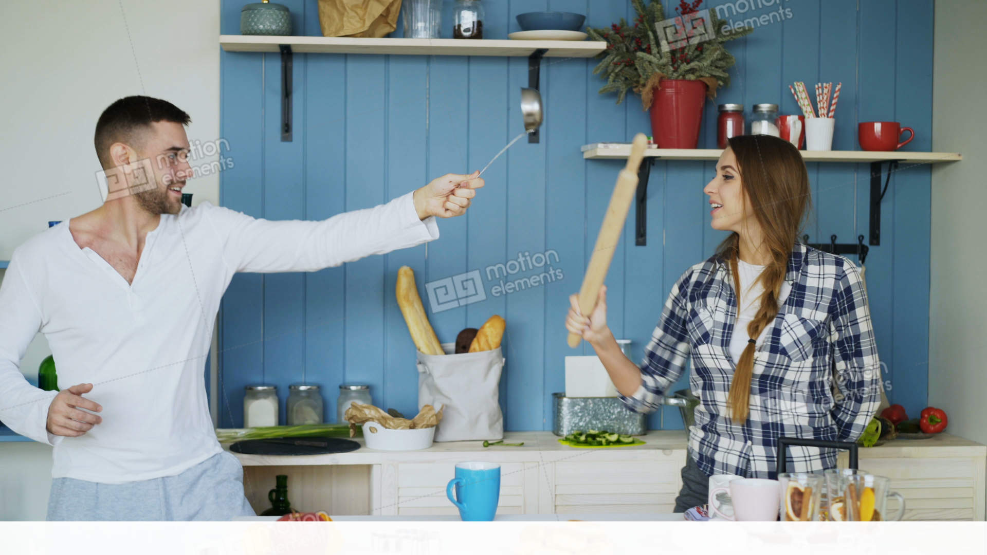 Happy Couple Having Fun In The Kitchen Fighting With Ladle And ...