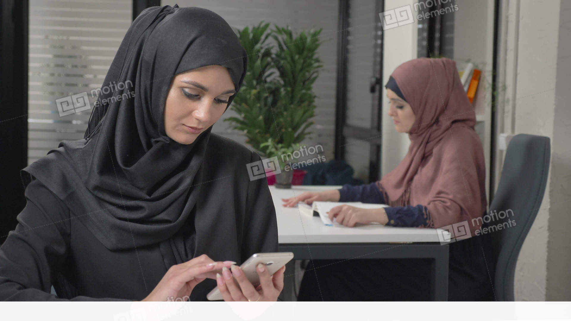 Young beautiful girl in black hijab with headset answers Stock Video  Footage