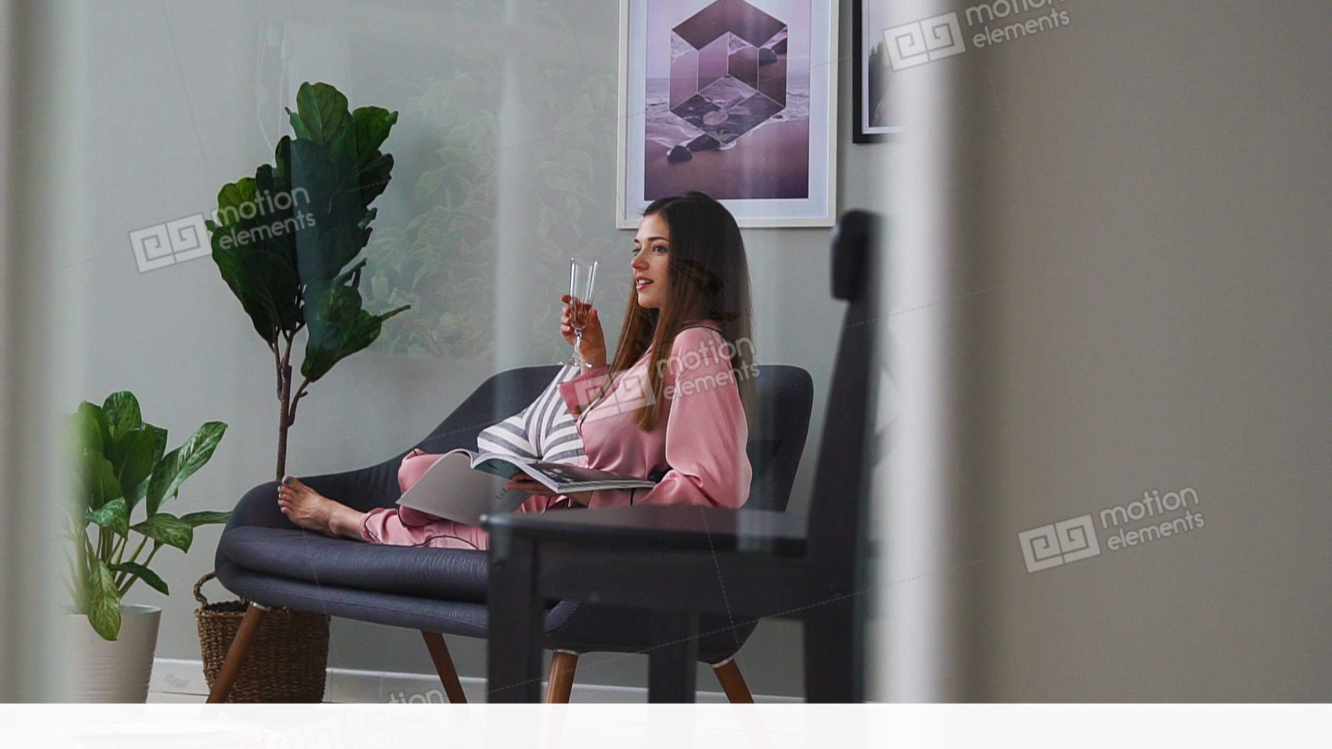 e68afb00a727 A beautiful girl in sexy pink pajamas reads a glossy... Stock Video Footage