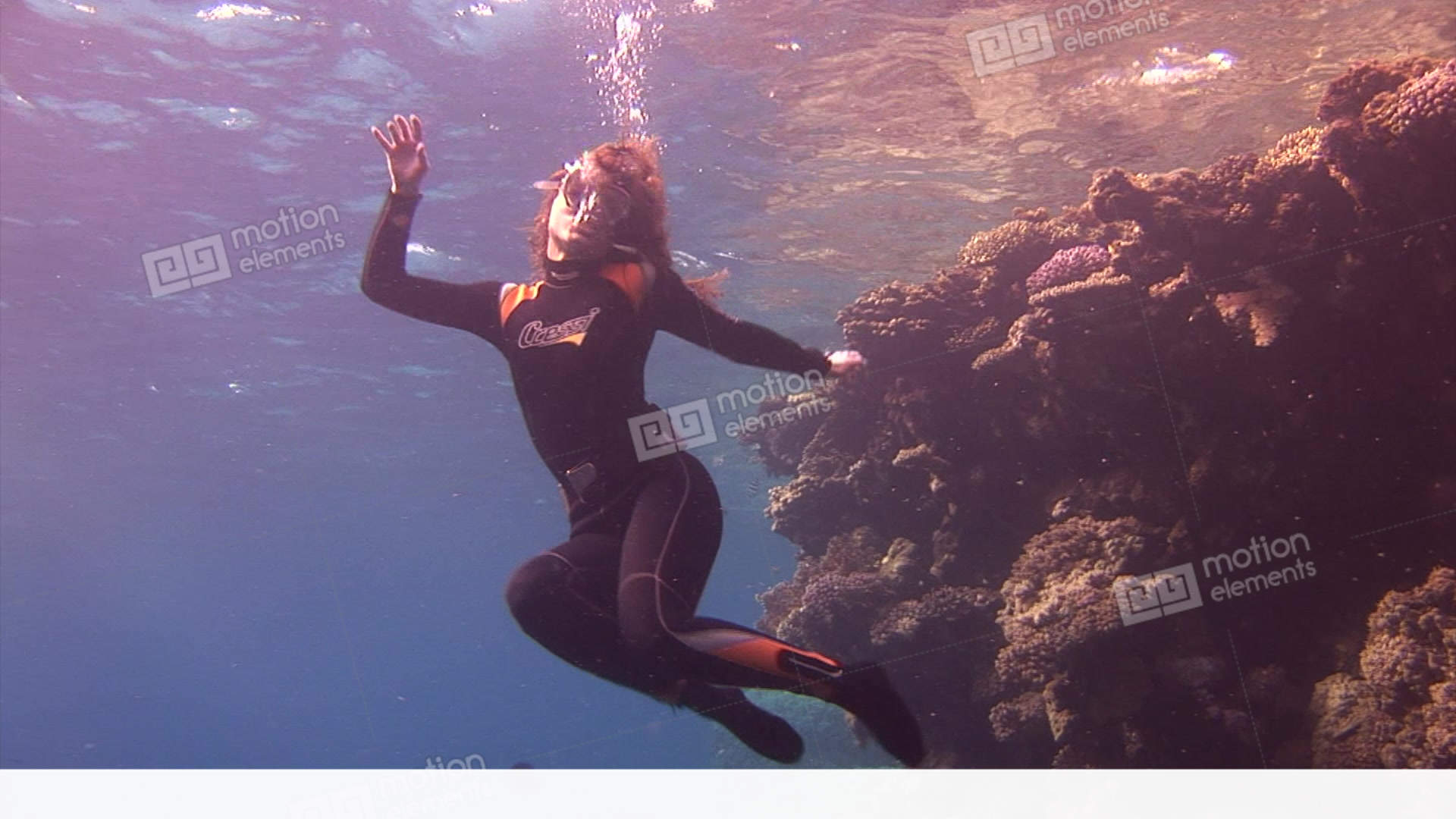 Underwater model free diver dancing in front of the camera in water