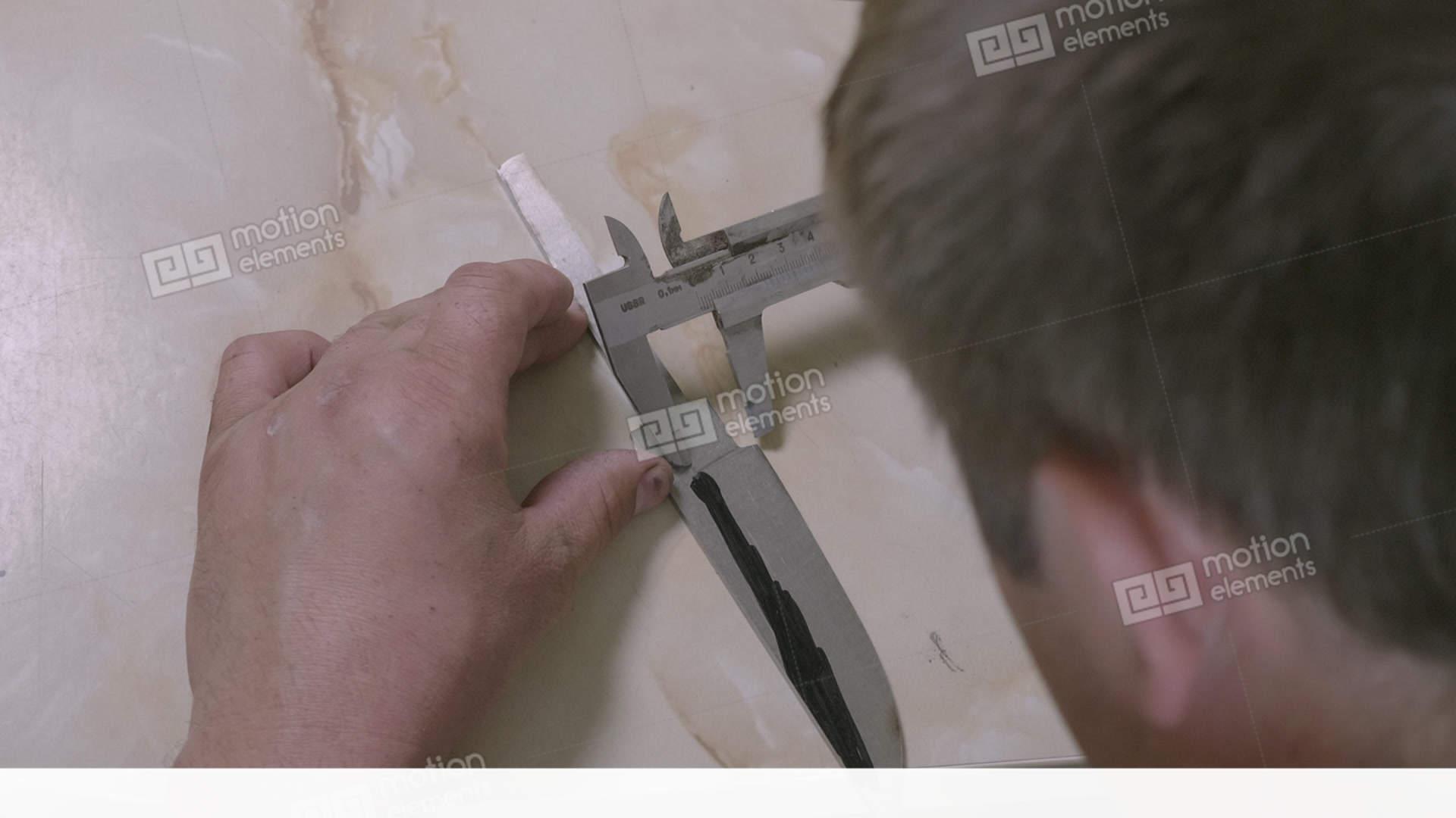Workman measuring handmade knife diy do it yourself close up of workman measuring handmade knife diy do it yourself stock video footage solutioingenieria Images