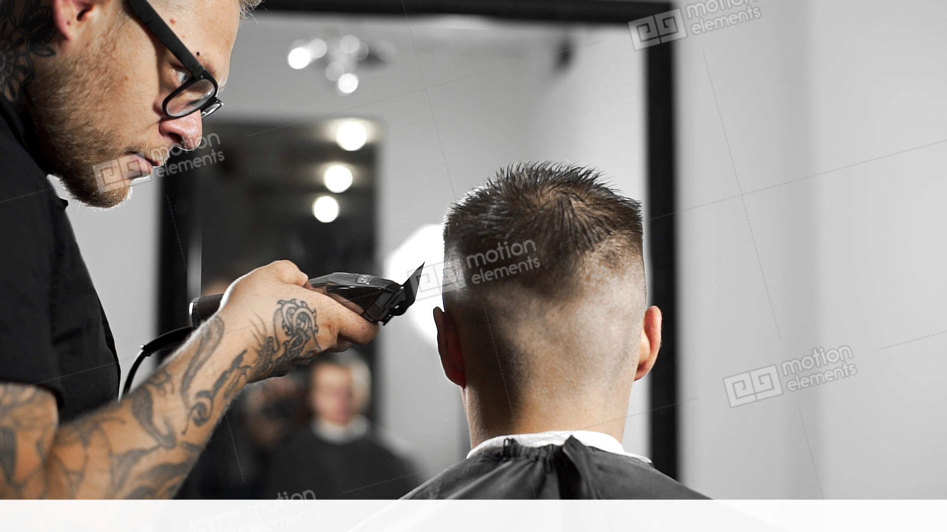 Tattoed Barber Makes Haircut For Customer At The Barber Shop By