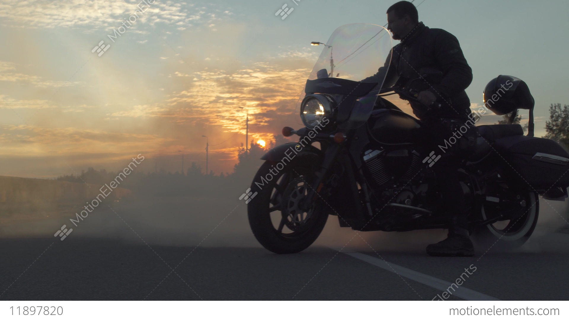 motorcycle background p  Biker Create A Lot Of Smoke With A Motorcycle On The Road, Sunset At ...