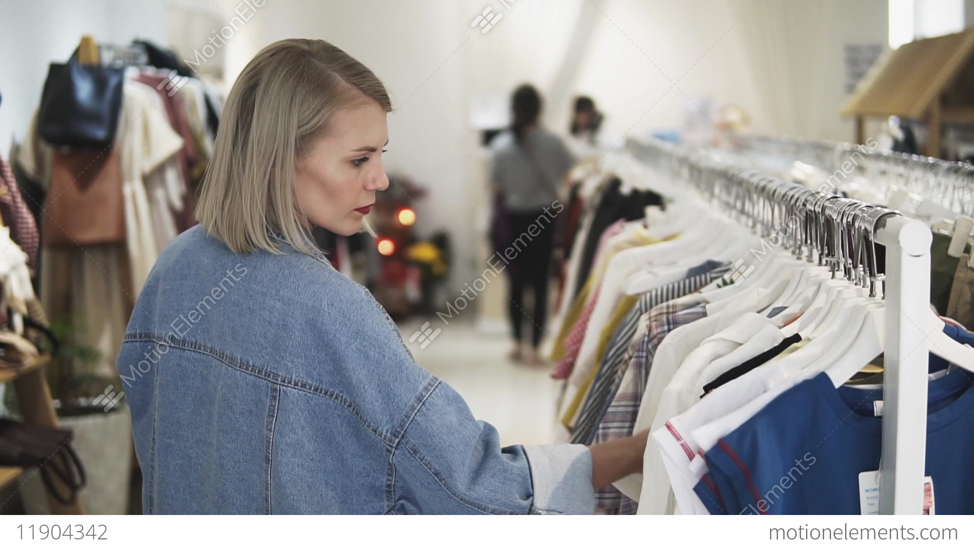 3aeffc309 Shopping girl. Portrait of a beautiful woman in the... Stock Video Footage