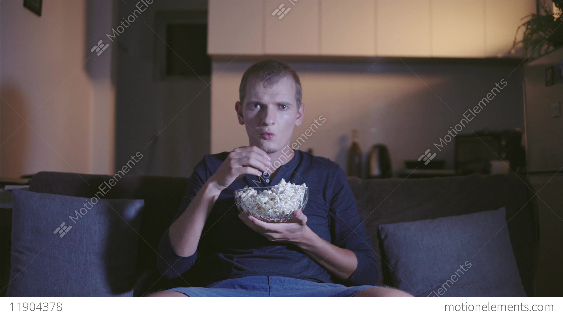 Adult Man Interestedly Watching Tv And Film Seating On Comfortable ...
