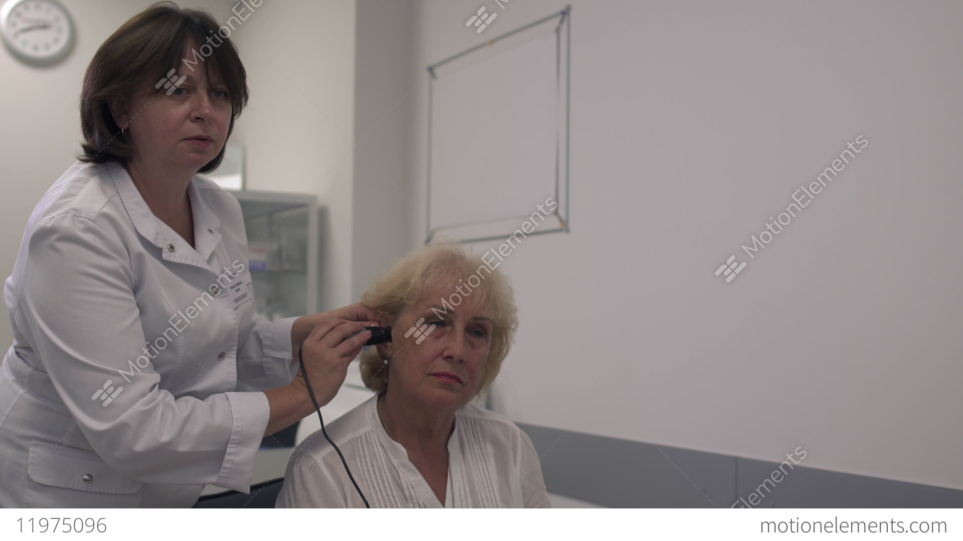 Medical professional tests the ear of an adult woman Stock Video Footage