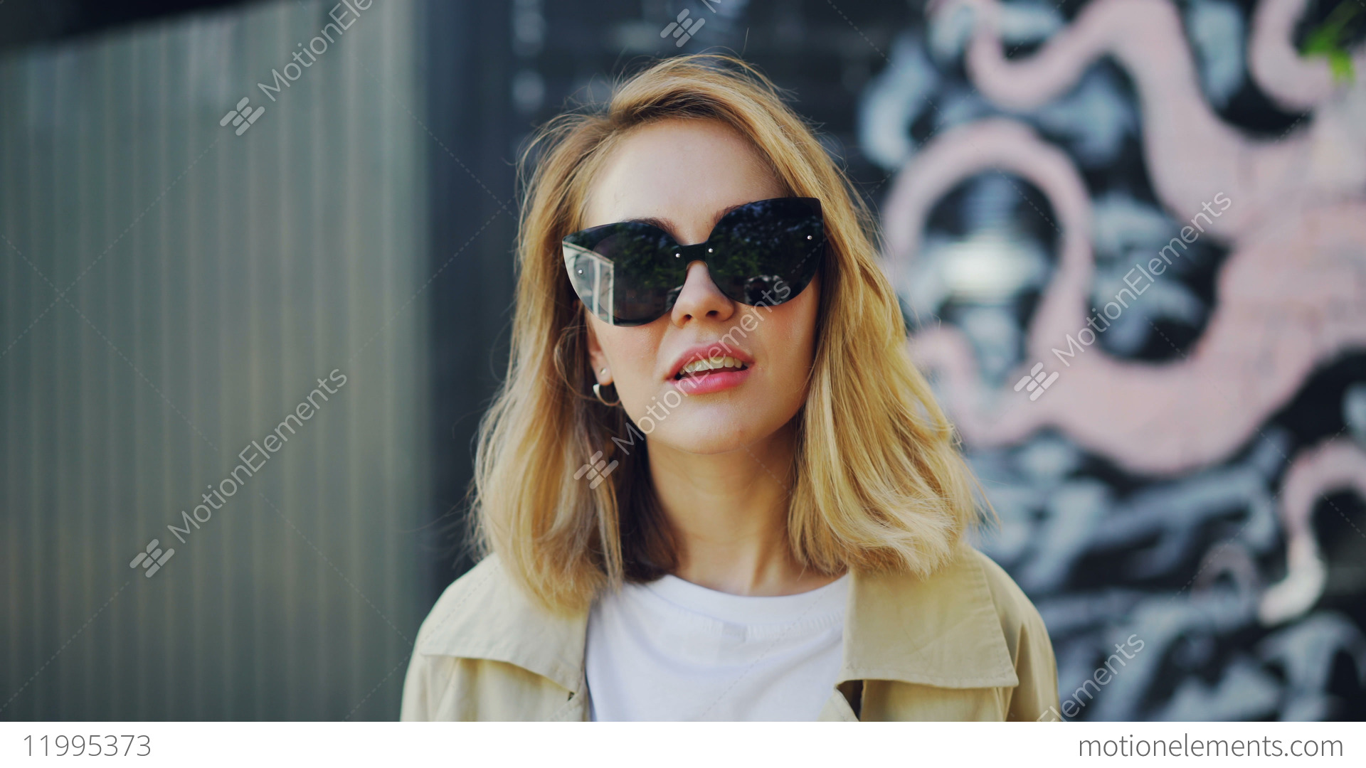 935bd4c906 Portrait of beautiful blond girl in sunglasses looking at... Stock Video  Footage