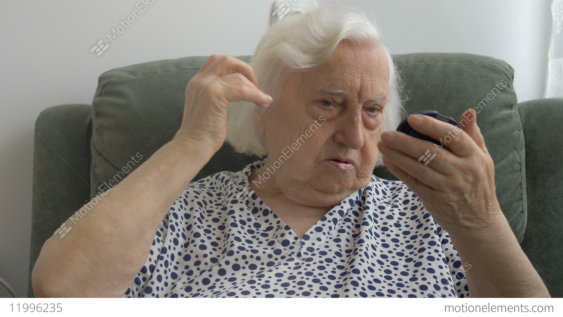 The Old Lady Corrects The Hairstyle And Looks In The Mirror Stock