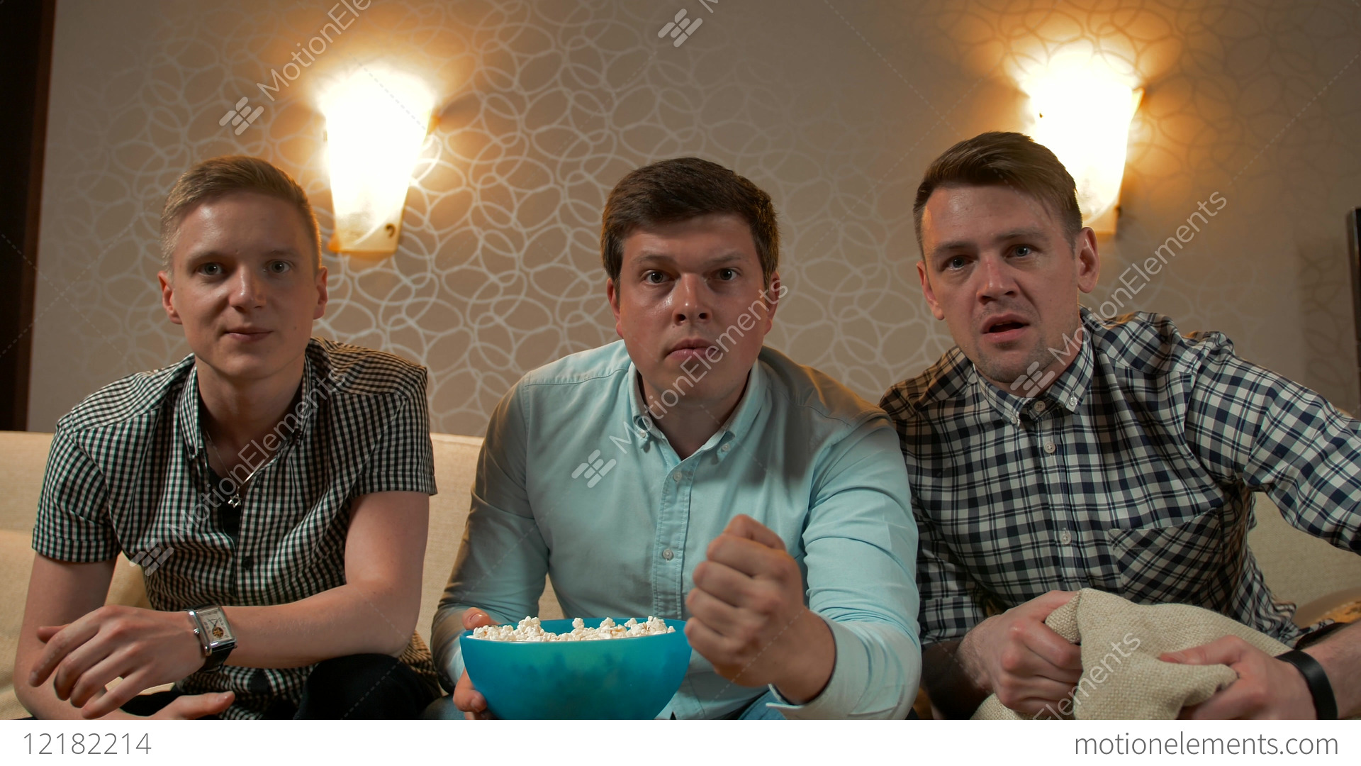 Three Best Friends Watching Football Tv At Home Enjoying Good Game