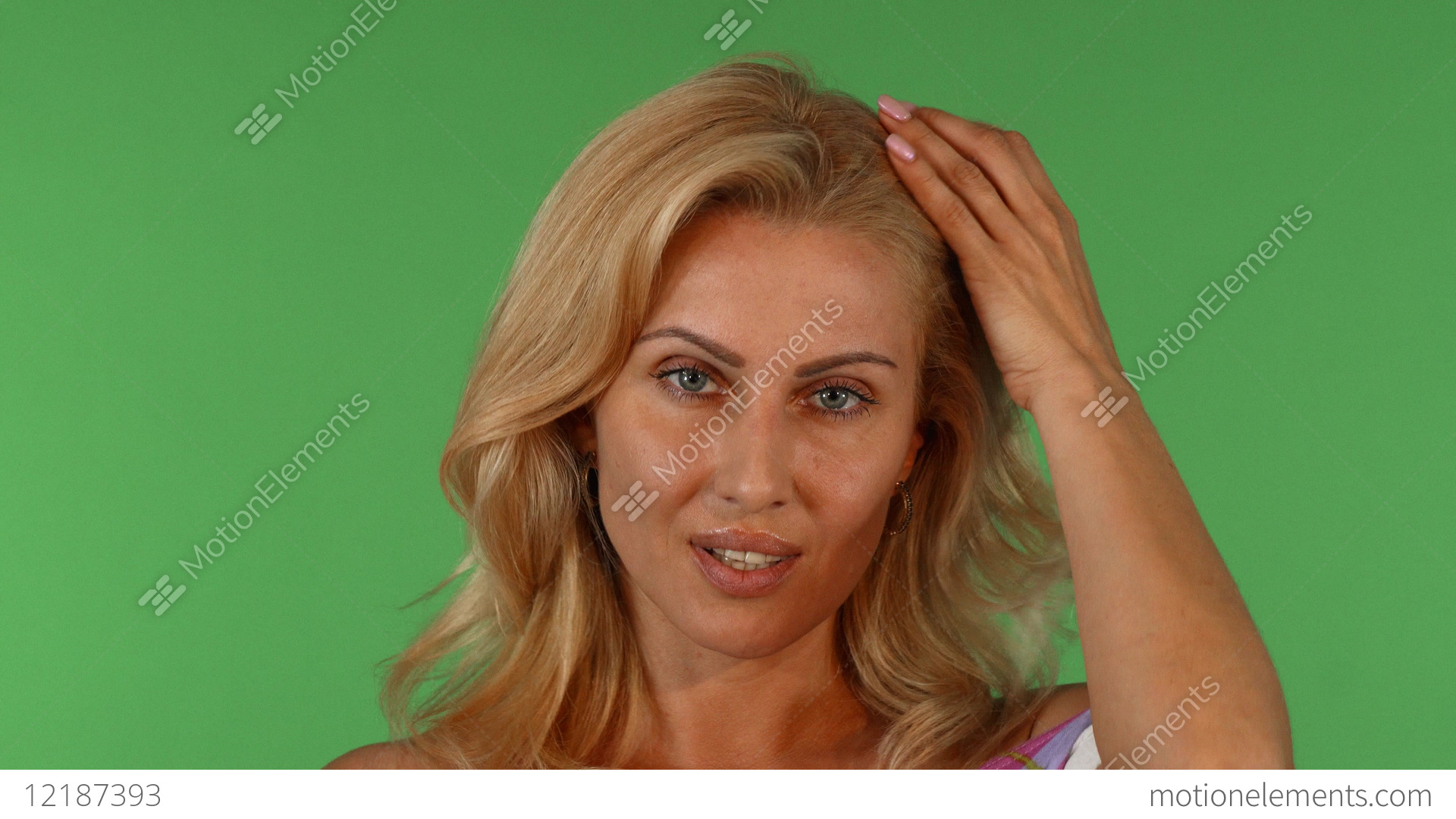 Portrait of a sexy mature woman on green background Stock Video Footage