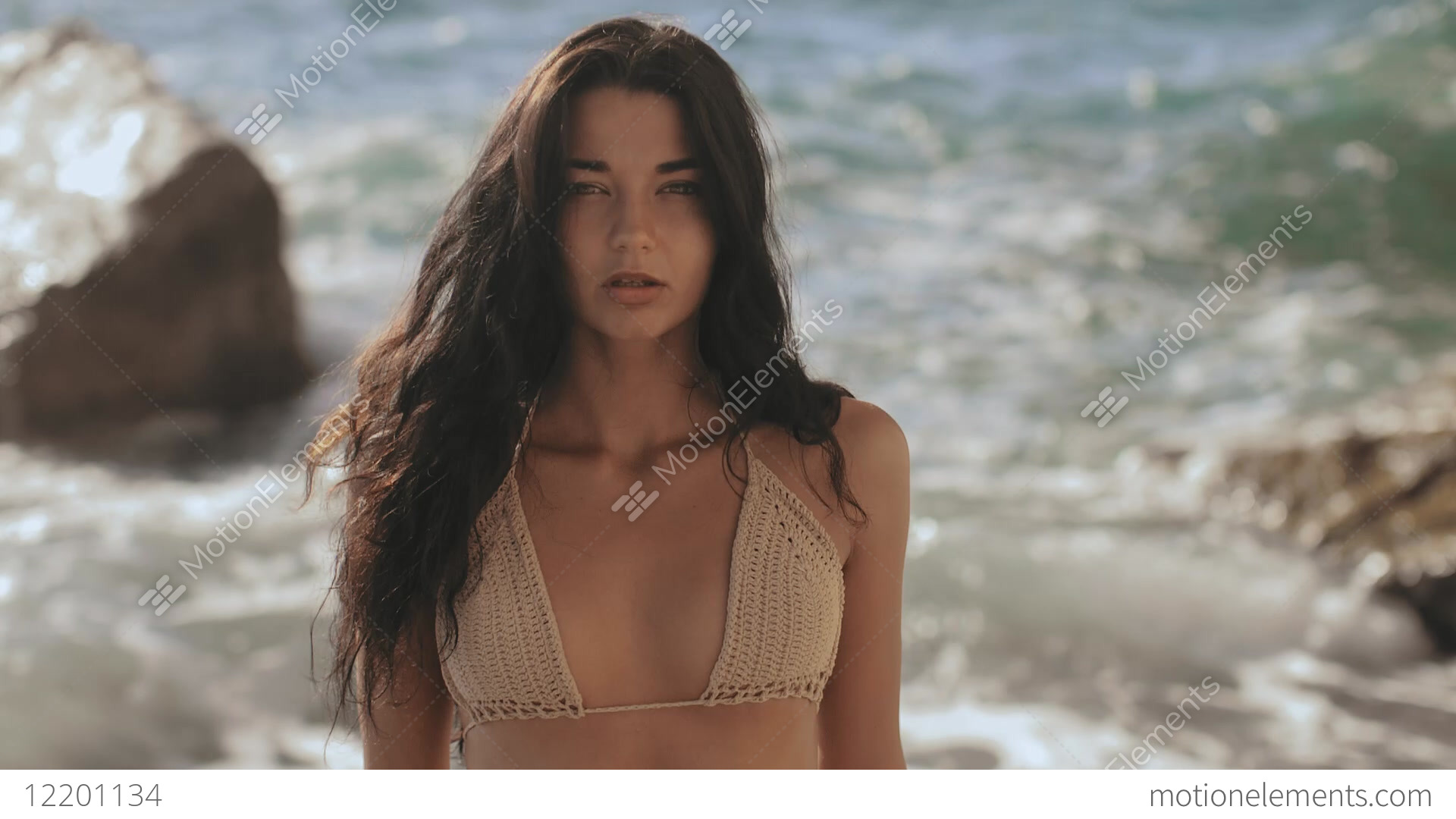 66cc6e77dd Portrait Of Beautiful Young Woman On Beach Stock video footage ...